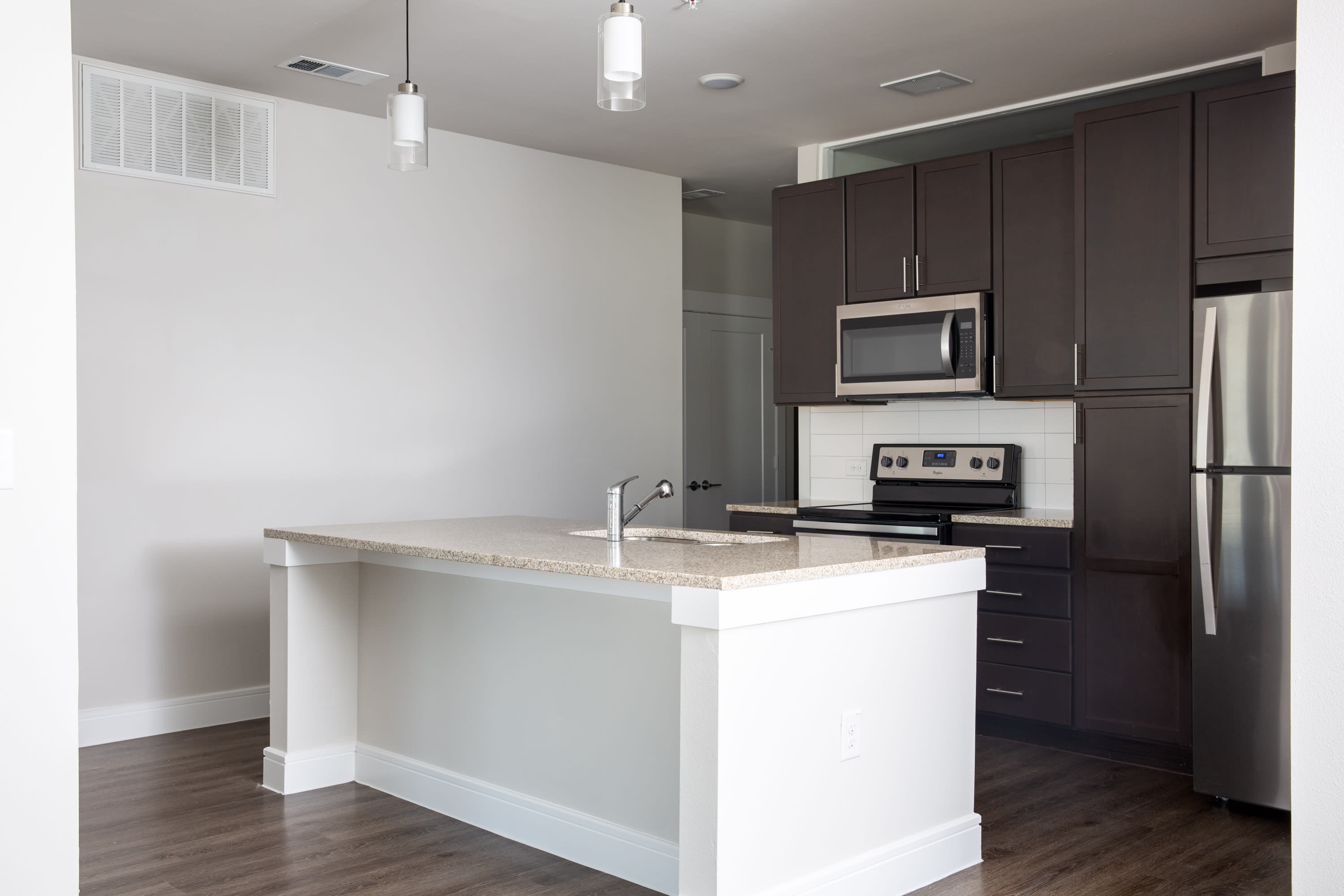 Model kitchen with island at Flora in Austin, Texas