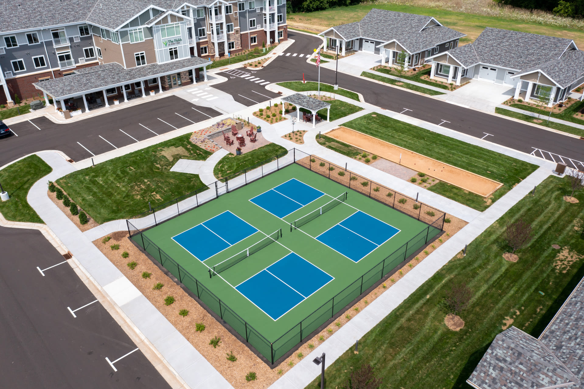 Aerial image showing tennis courts and parking at The Fields at Arbor Glen in Lake Elmo, Minnesota