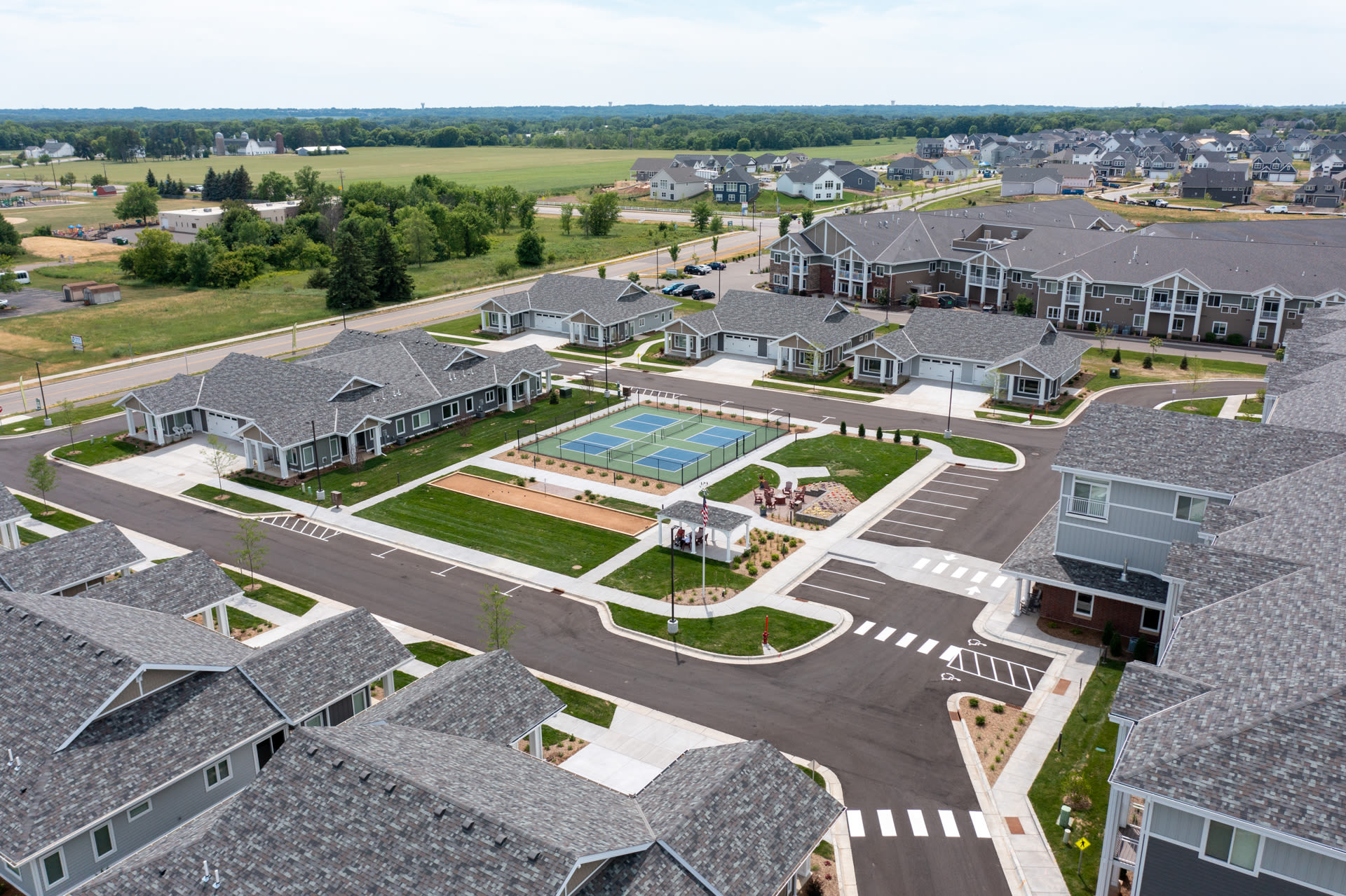Aerial image showing road near tennis courts at The Fields at Arbor Glen in Lake Elmo, Minnesota