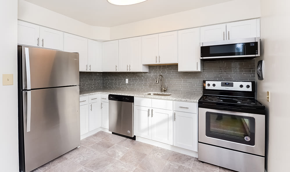 Fully-equipped kitchen at Brockport Crossings Apartments & Townhomes in Brockport, New York