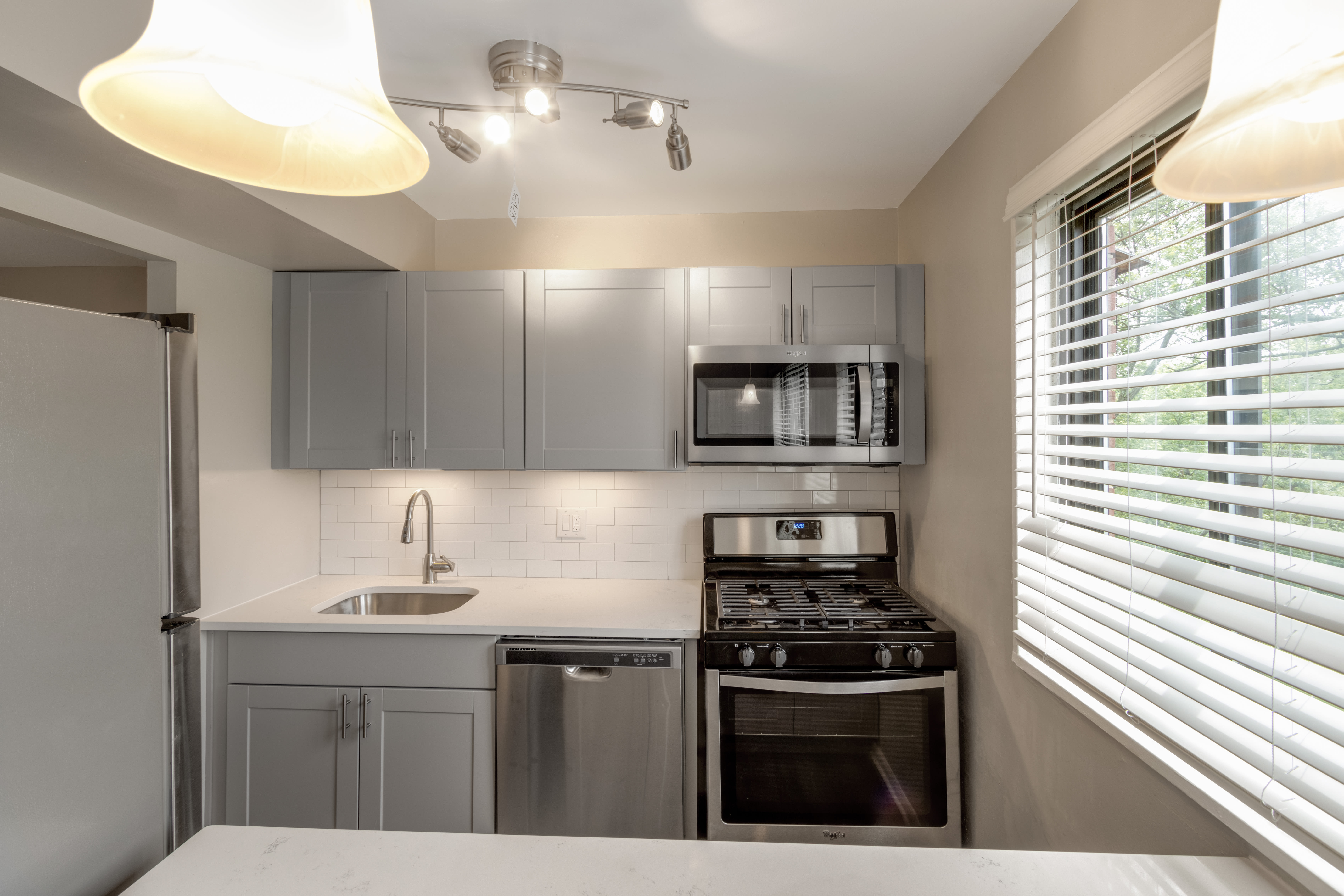 A kitchen with black appliances at Regency Pointe in Forestville, Maryland