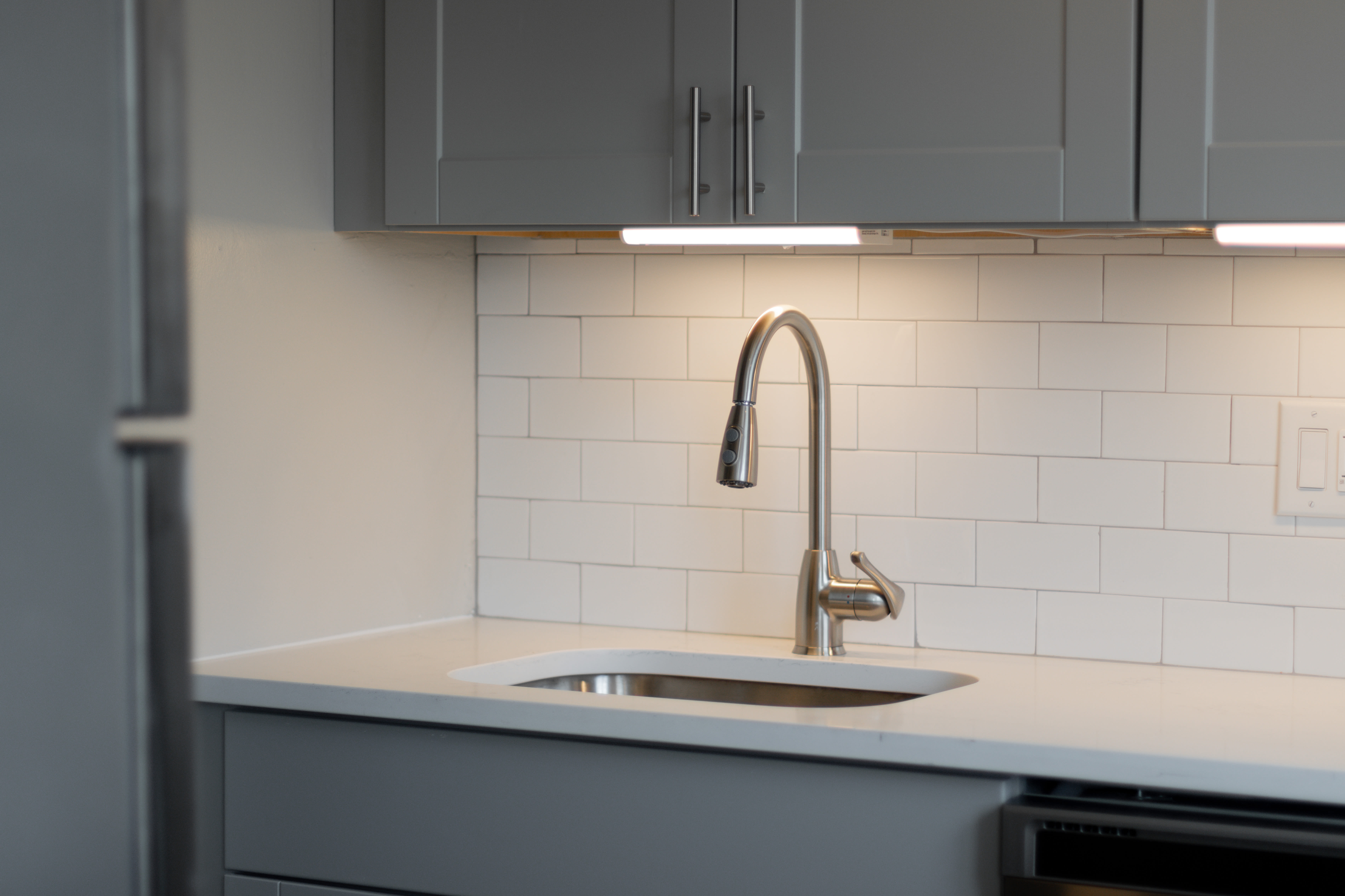 sink with lighting at Regency Pointe in Forestville, Maryland
