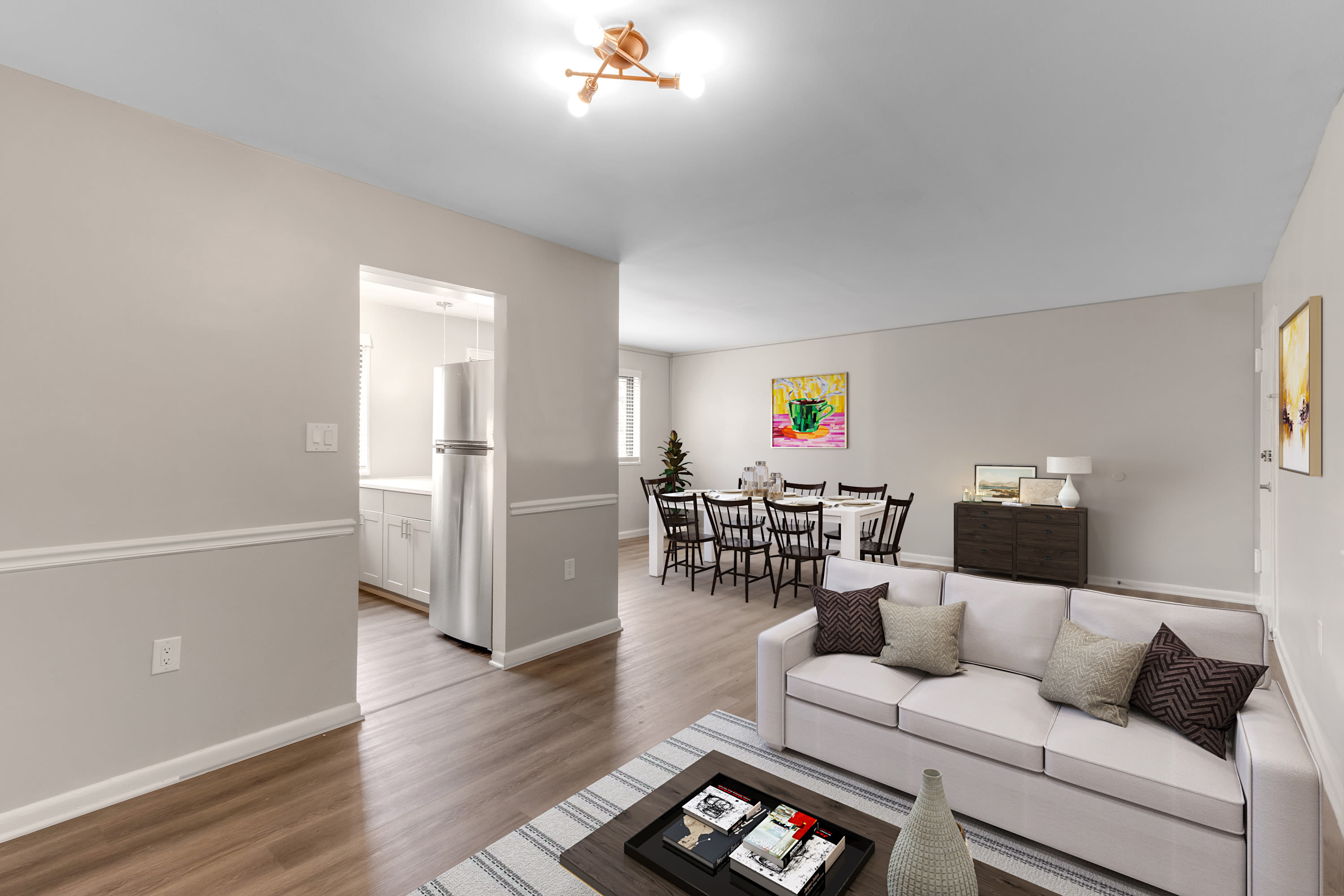 A dining room and living room at Regency Pointe in Forestville, Maryland
