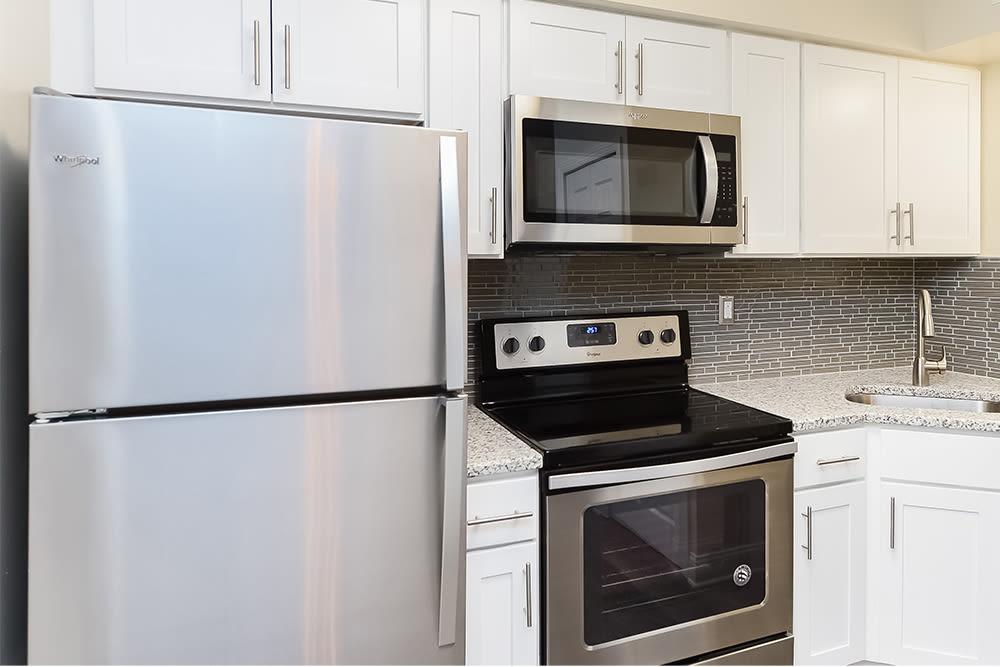 Fully-equipped kitchen at Idylwood Resort Apartments in Cheektowaga, New York