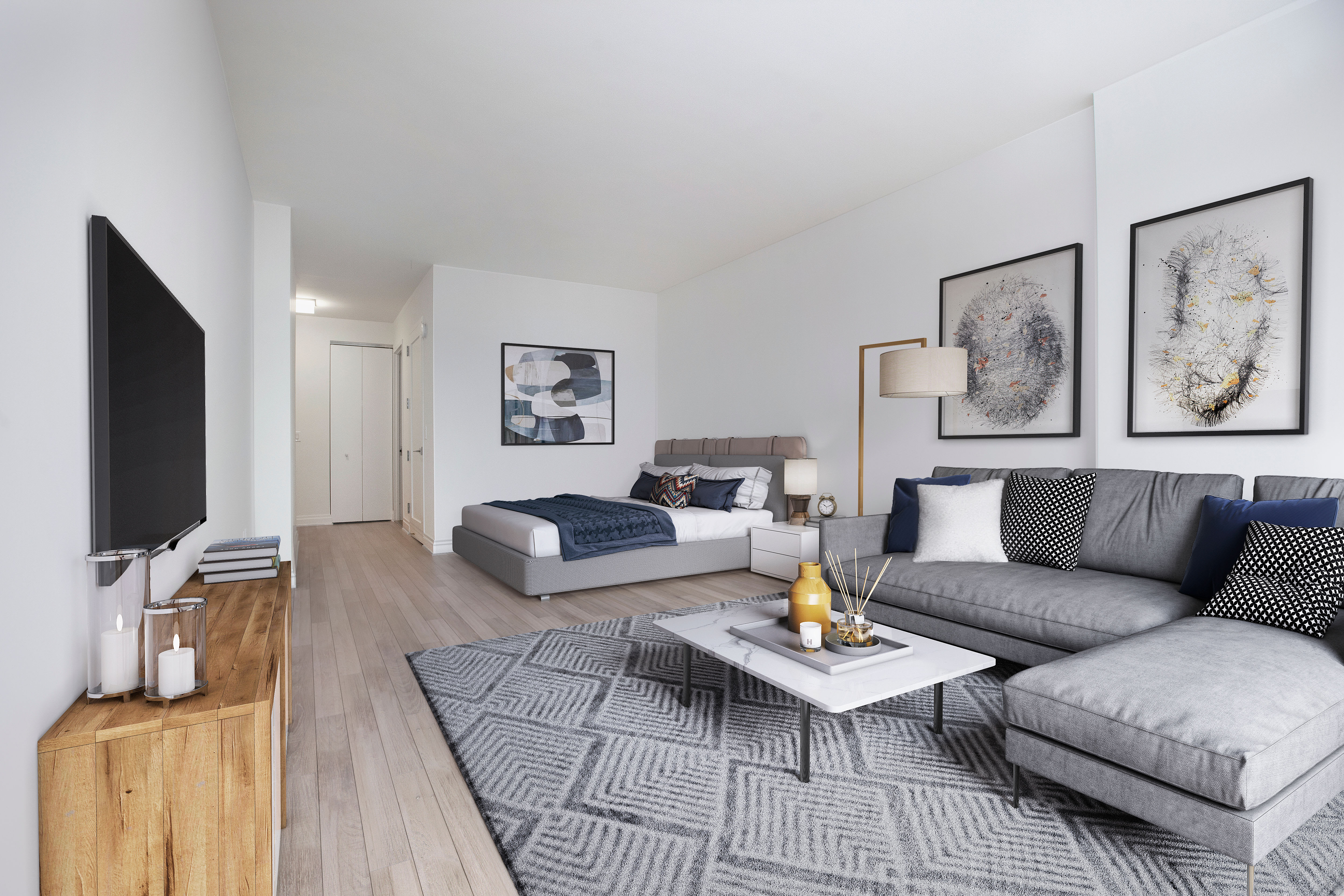 Large living area of a studio apartment at The Ventura in New York, New York