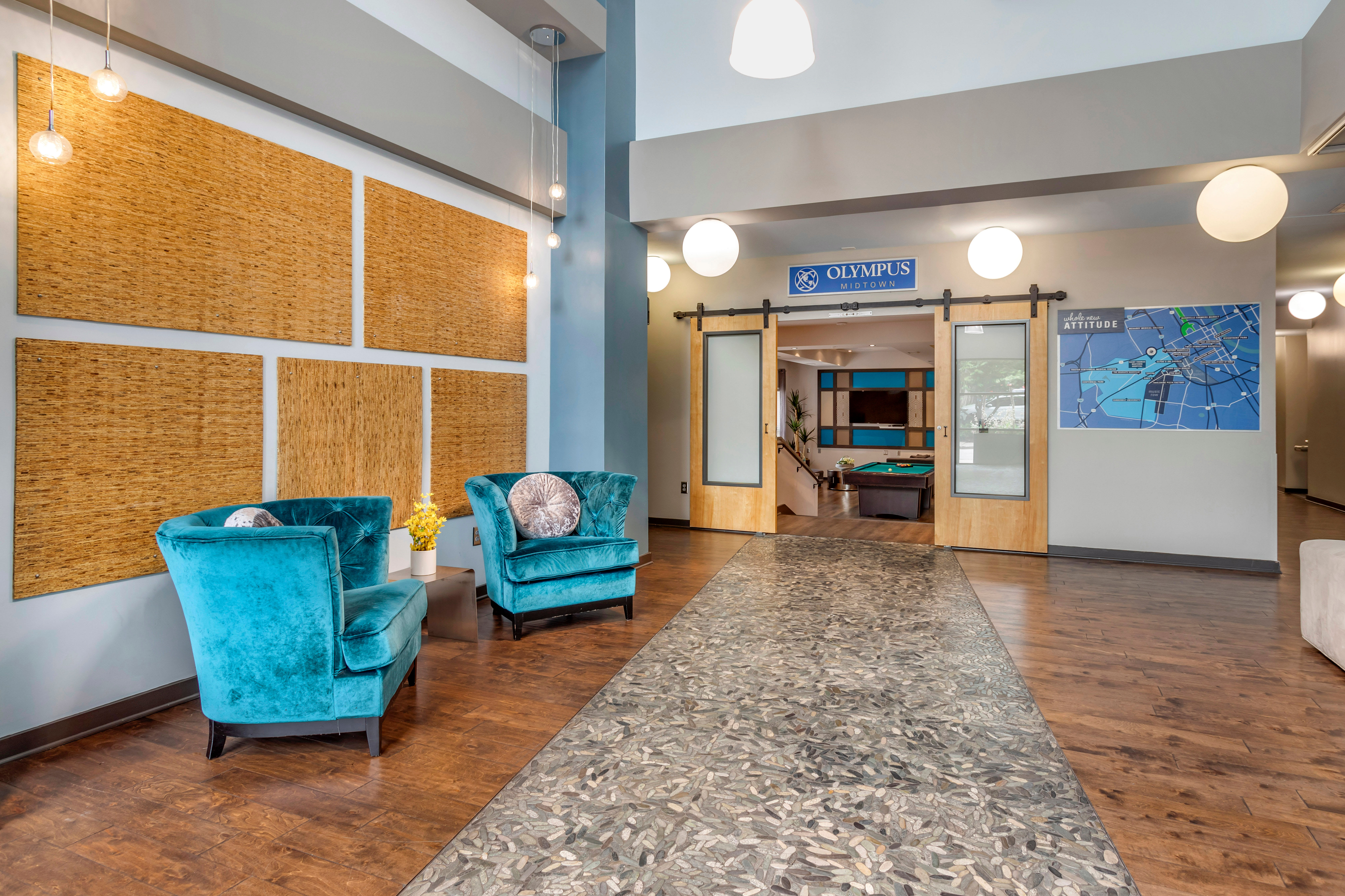 Bright and welcoming lobby interior at Olympus Midtown in Nashville, Tennessee
