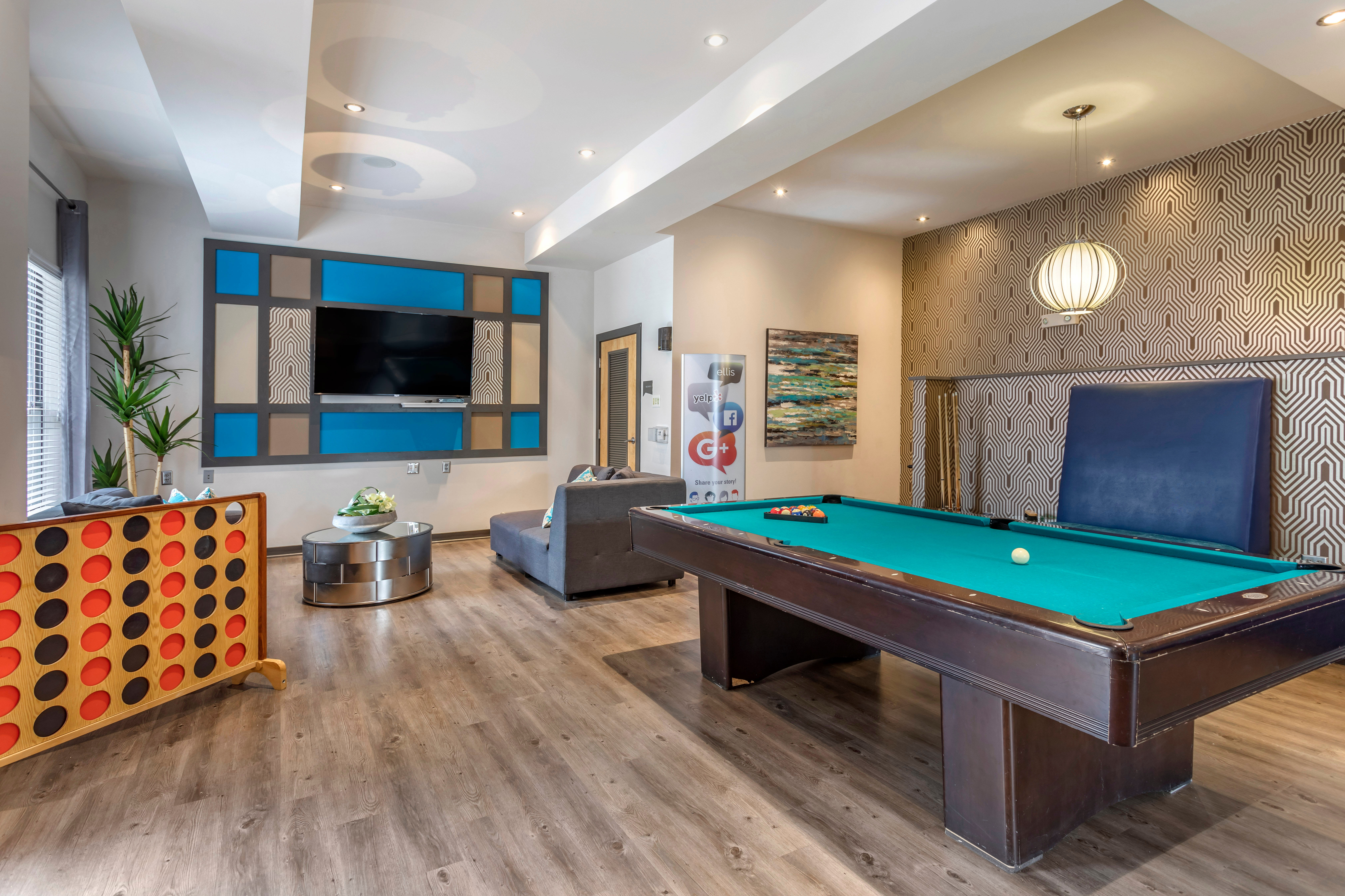 Billiards table in the game area of the clubhouse at Olympus Midtown in Nashville, Tennessee