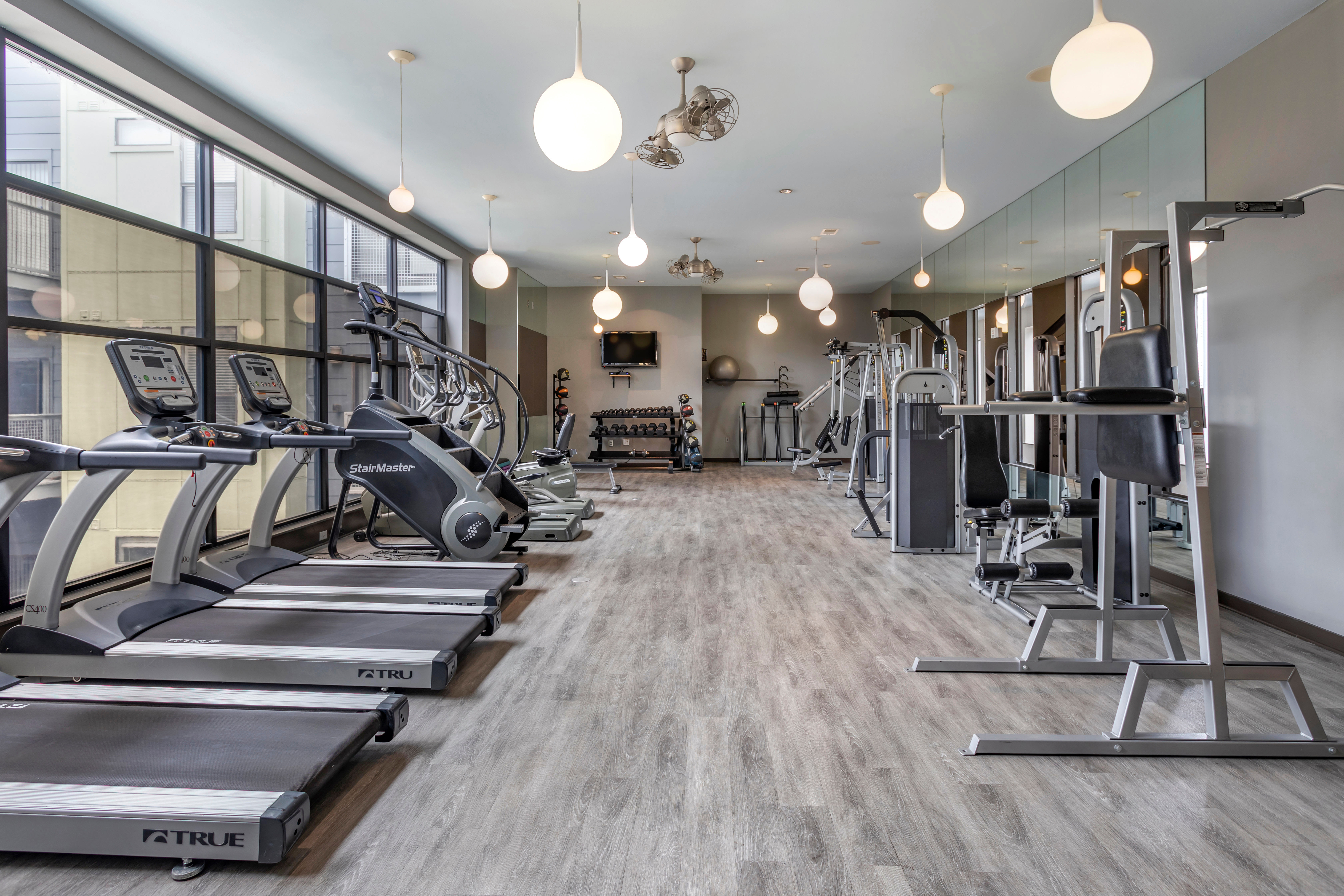Ample treadmills and cardio machines in the fitness center at Olympus Midtown in Nashville, Tennessee