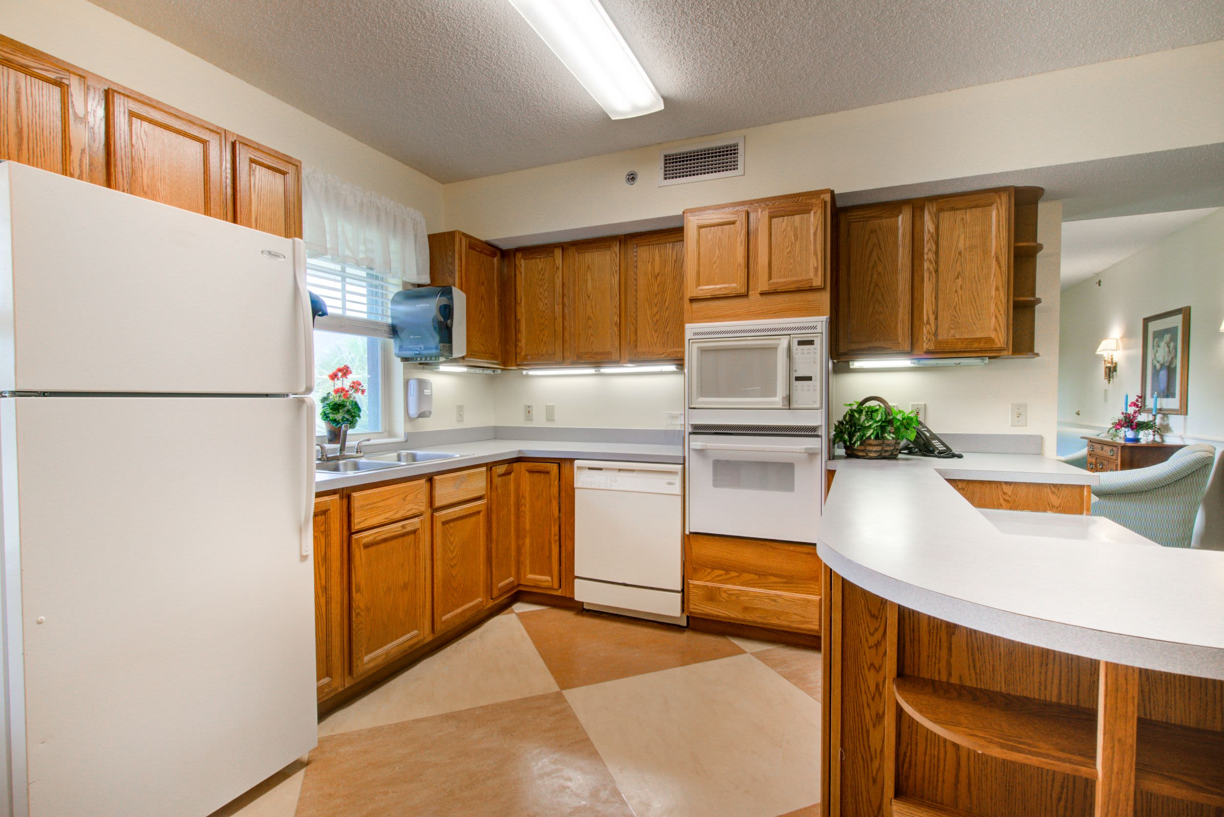 An apartment kitchen at Truewood by Merrill, Charlotte Center in Port Charlotte, Florida