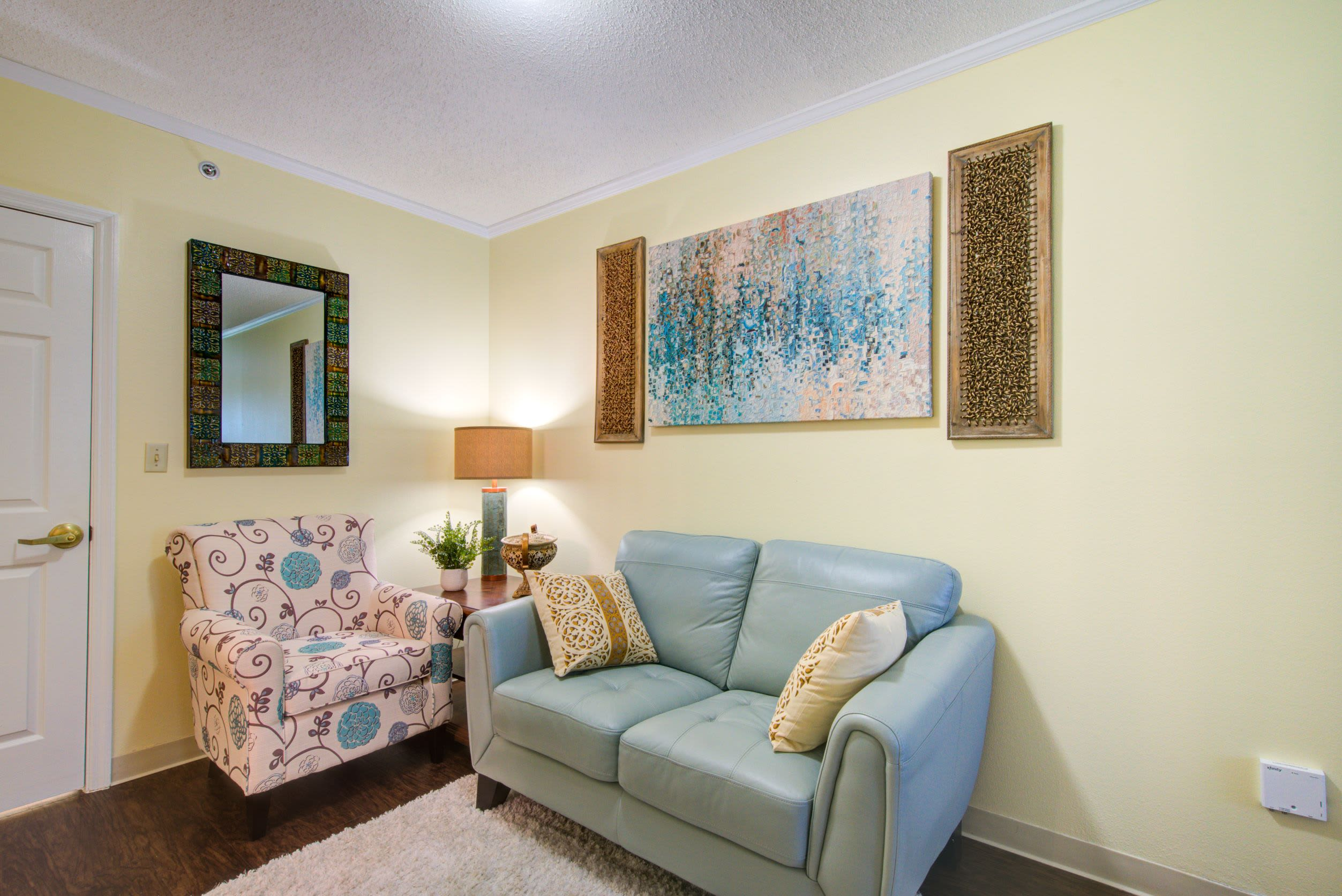 A resident living room at Truewood by Merrill, Charlotte Center in Port Charlotte, Florida