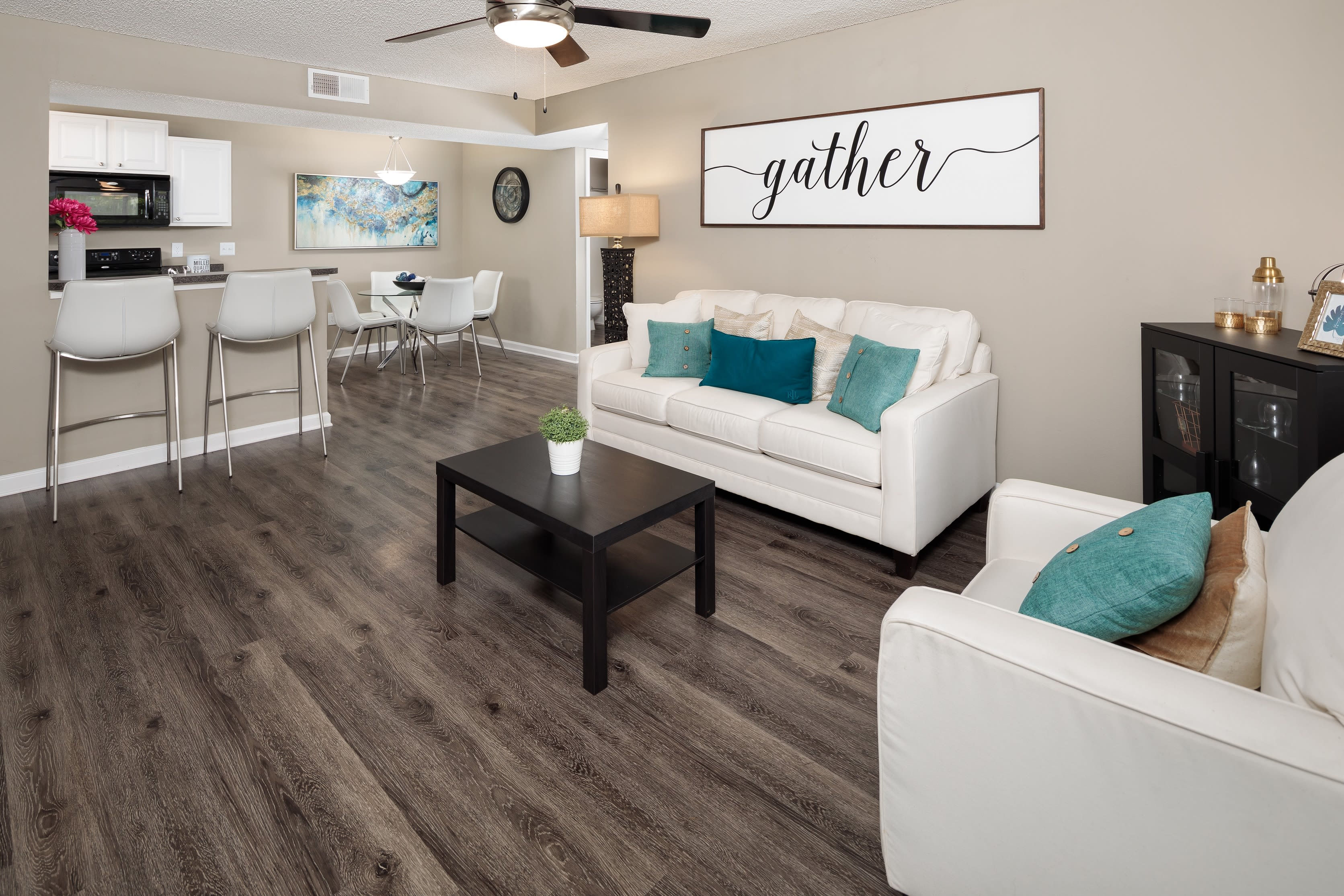 A living room in an apartment at 1801 MetroWest in Orlando, Florida