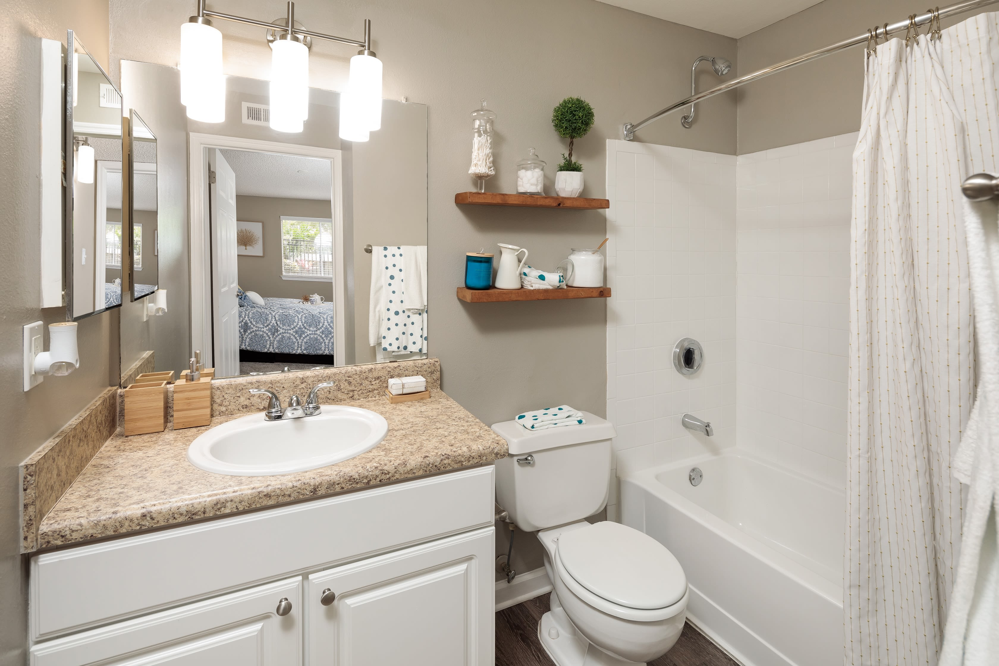 A well decorated bathroom in an apartment at 1801 MetroWest in Orlando, Florida