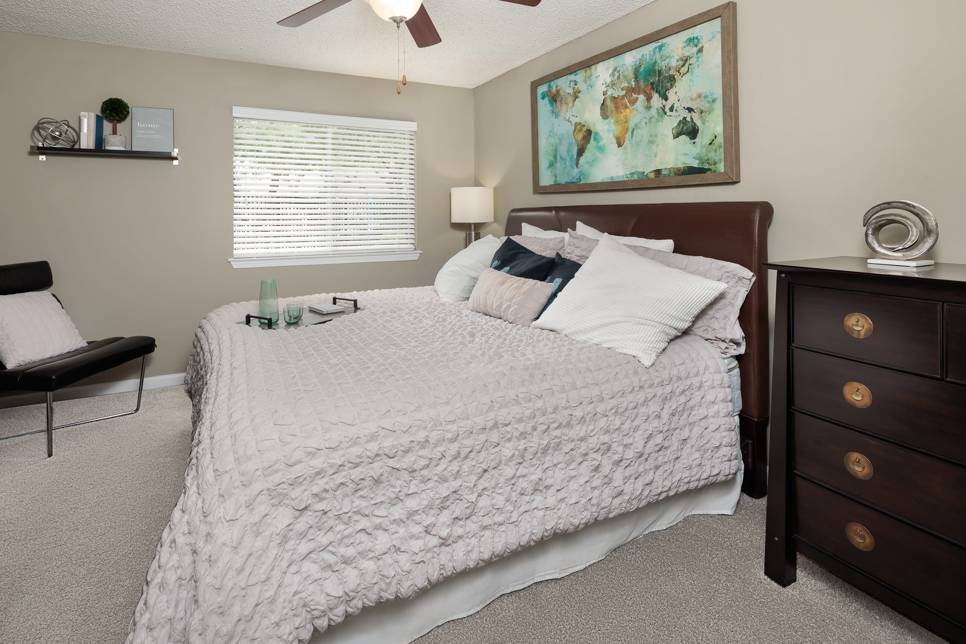 A furnished bedroom in an apartment at 1801 MetroWest in Orlando, Florida