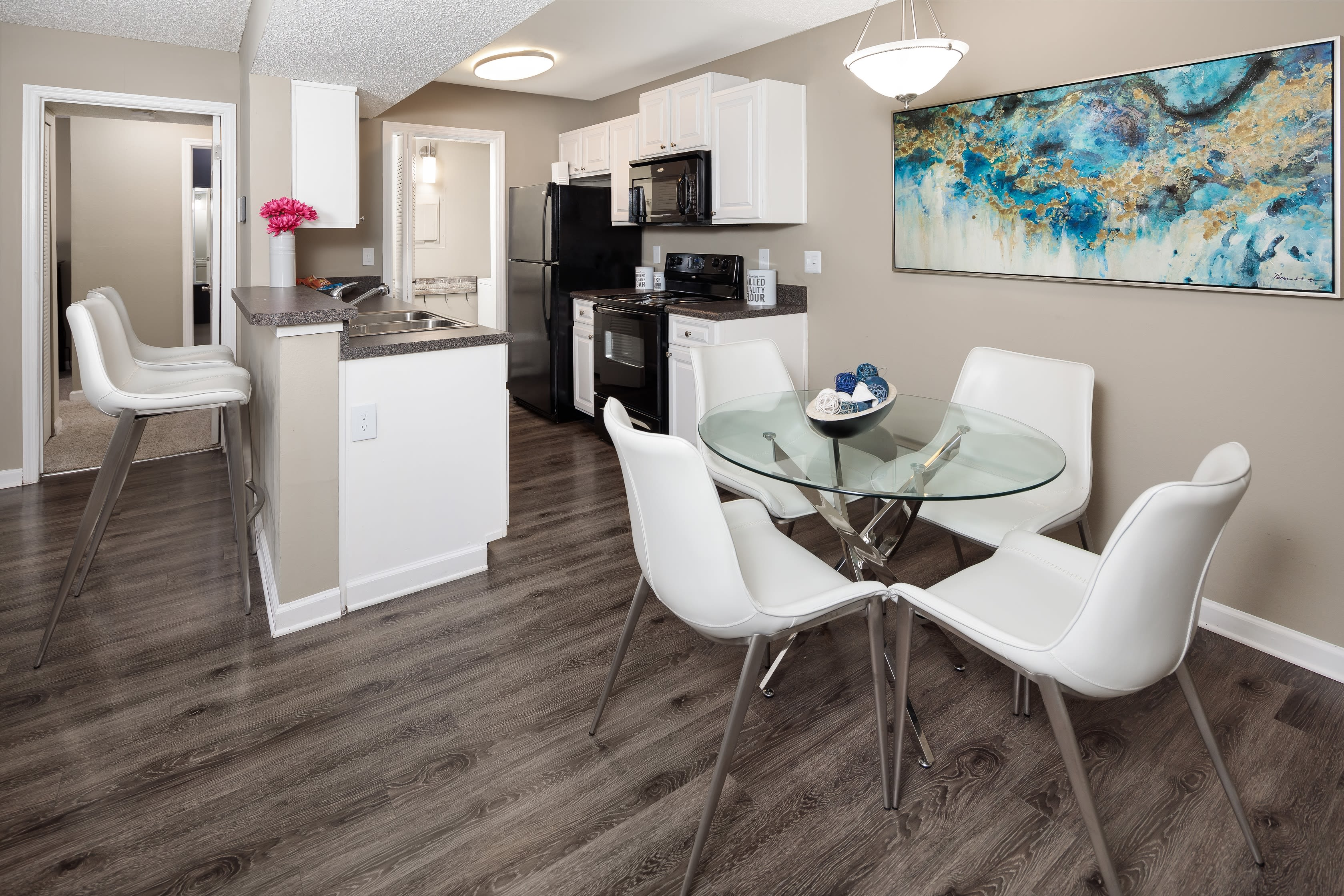 A dining area in an apartment at 1801 MetroWest in Orlando, Florida