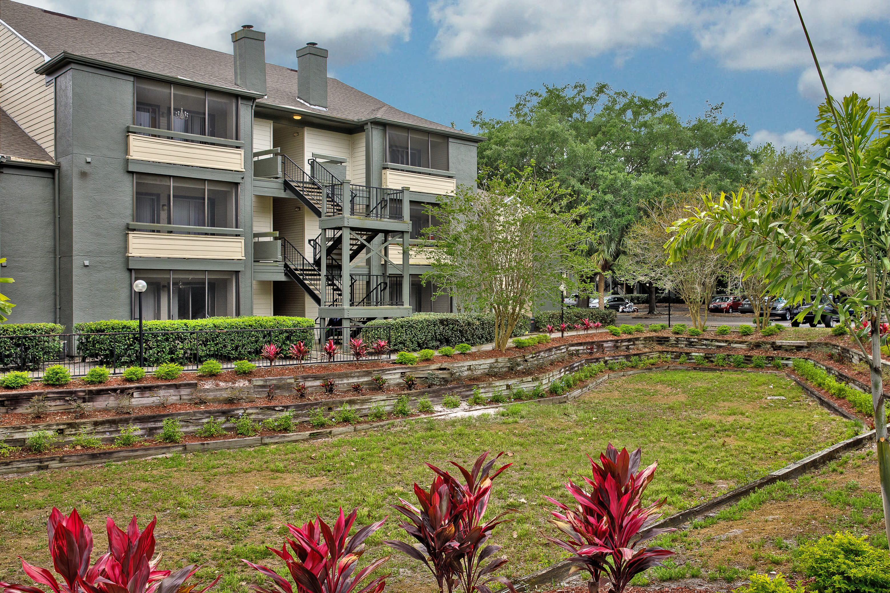 A lush landscape outside at 1801 MetroWest in Orlando, Florida