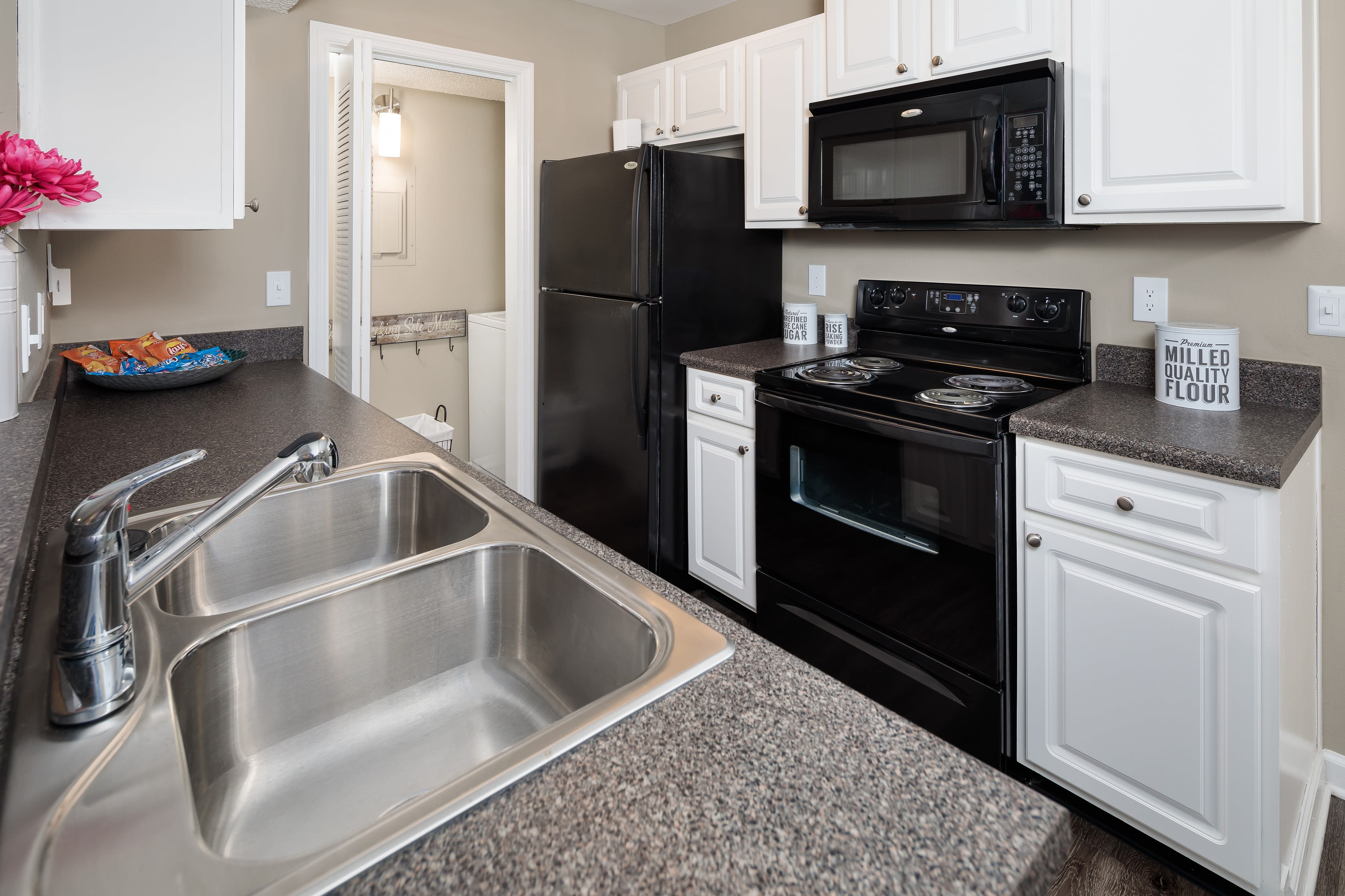An updated kitchen in an apartment at 1801 MetroWest in Orlando, Florida