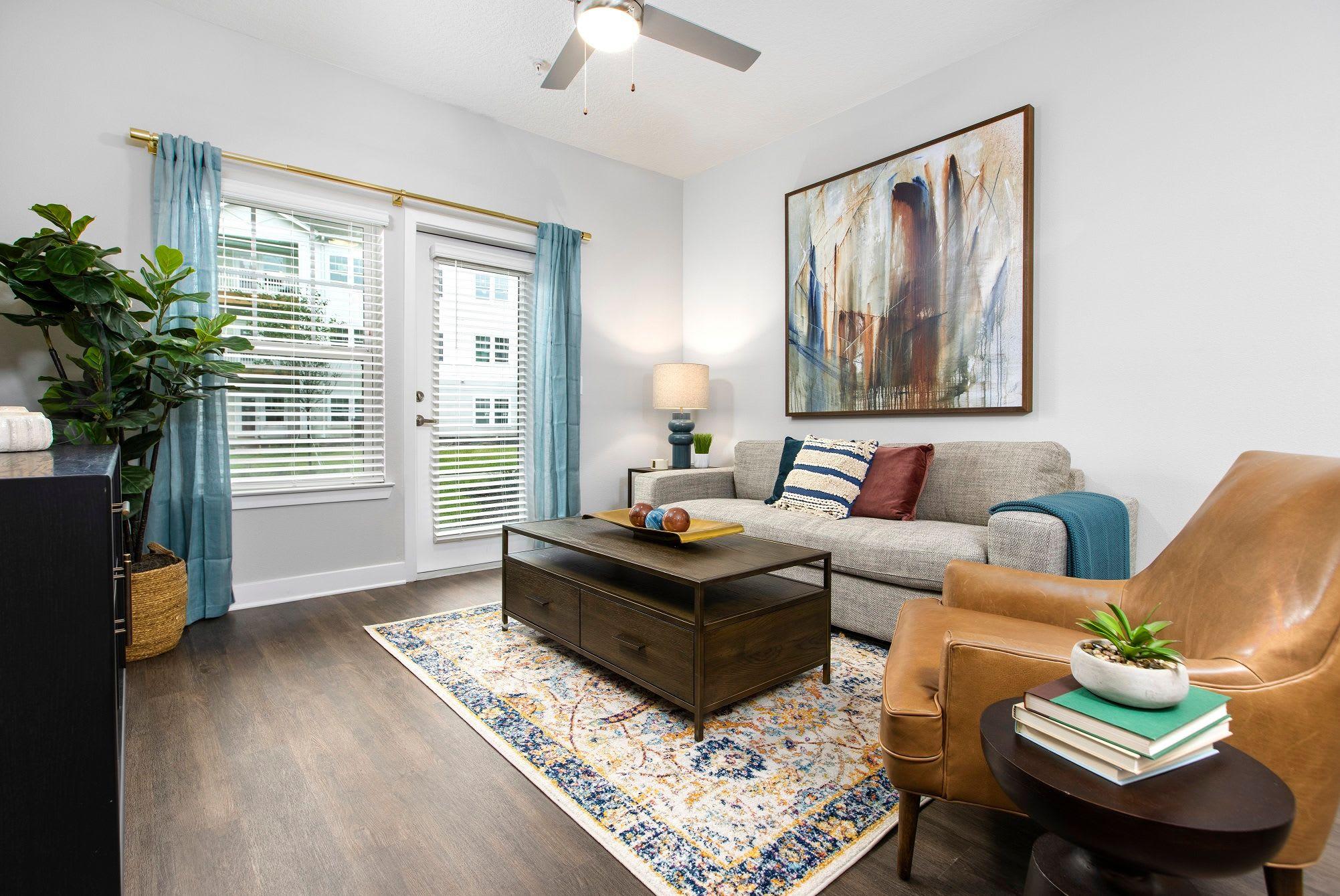 Open living room at Argyle at Oakleaf Town Center in Jacksonville, Florida