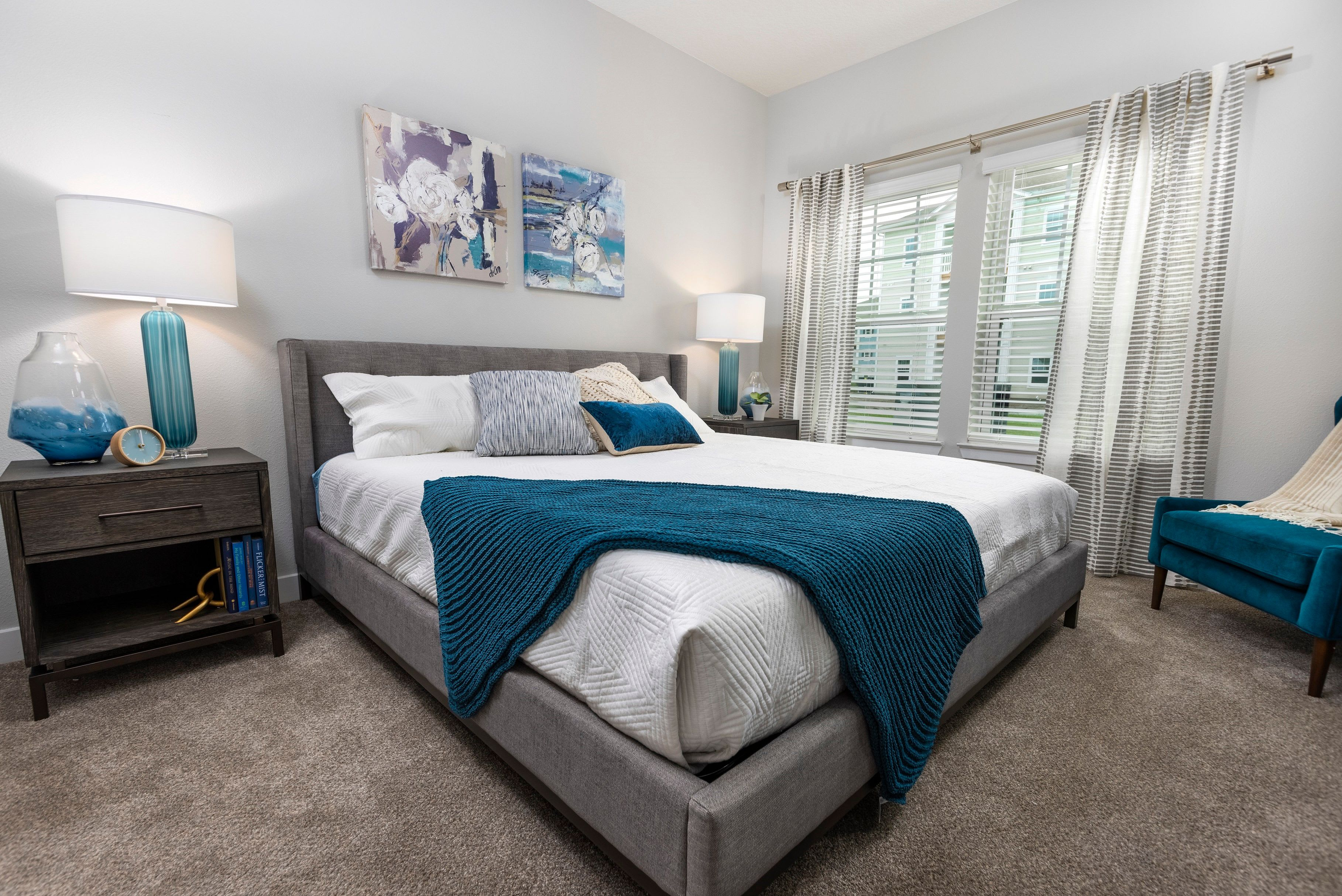 Well-decorated bedroom in model home at Argyle at Oakleaf Town Center in Jacksonville, Florida