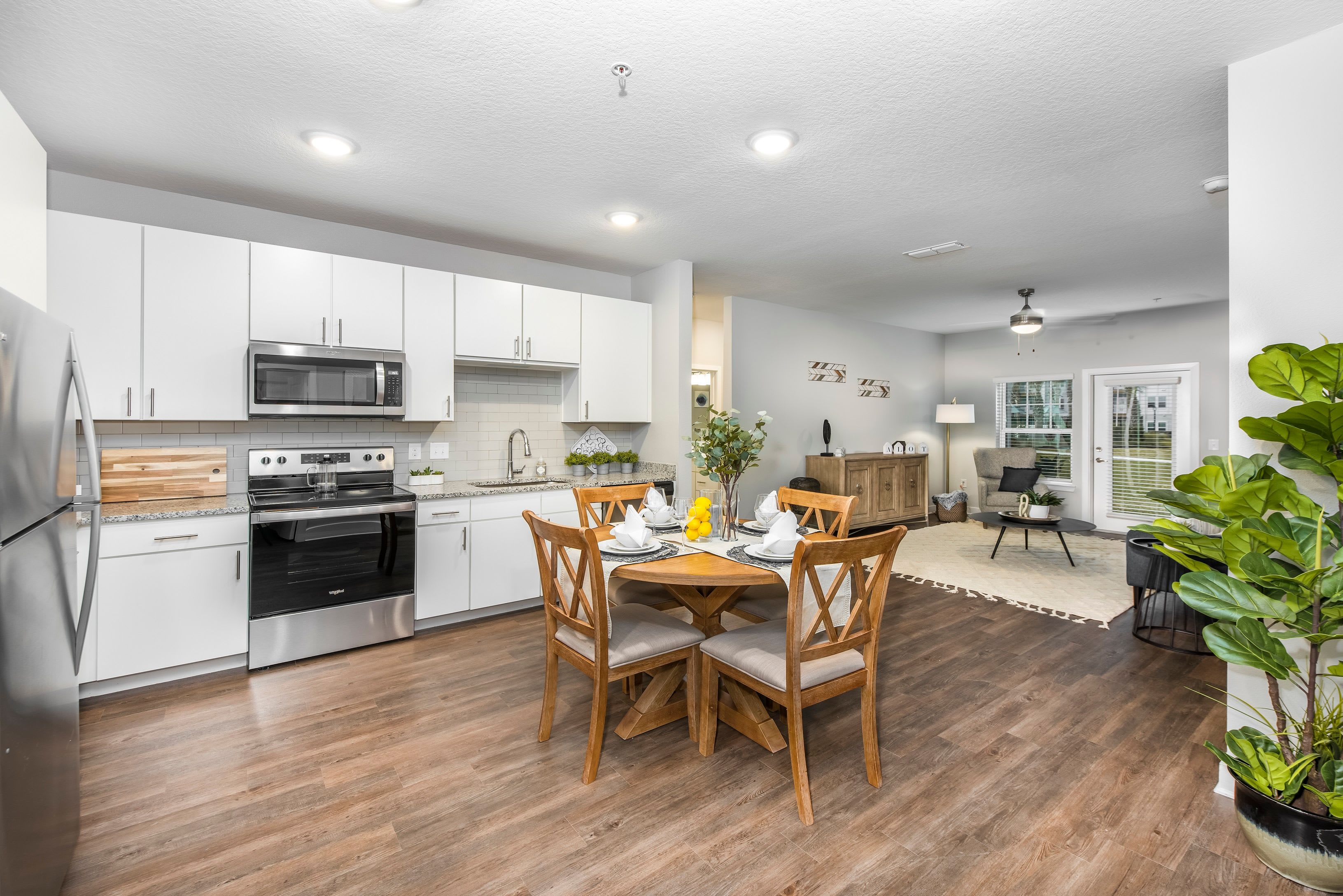 Open concept dining area with wood floors at Argyle at Oakleaf Town Center in Jacksonville, Florida