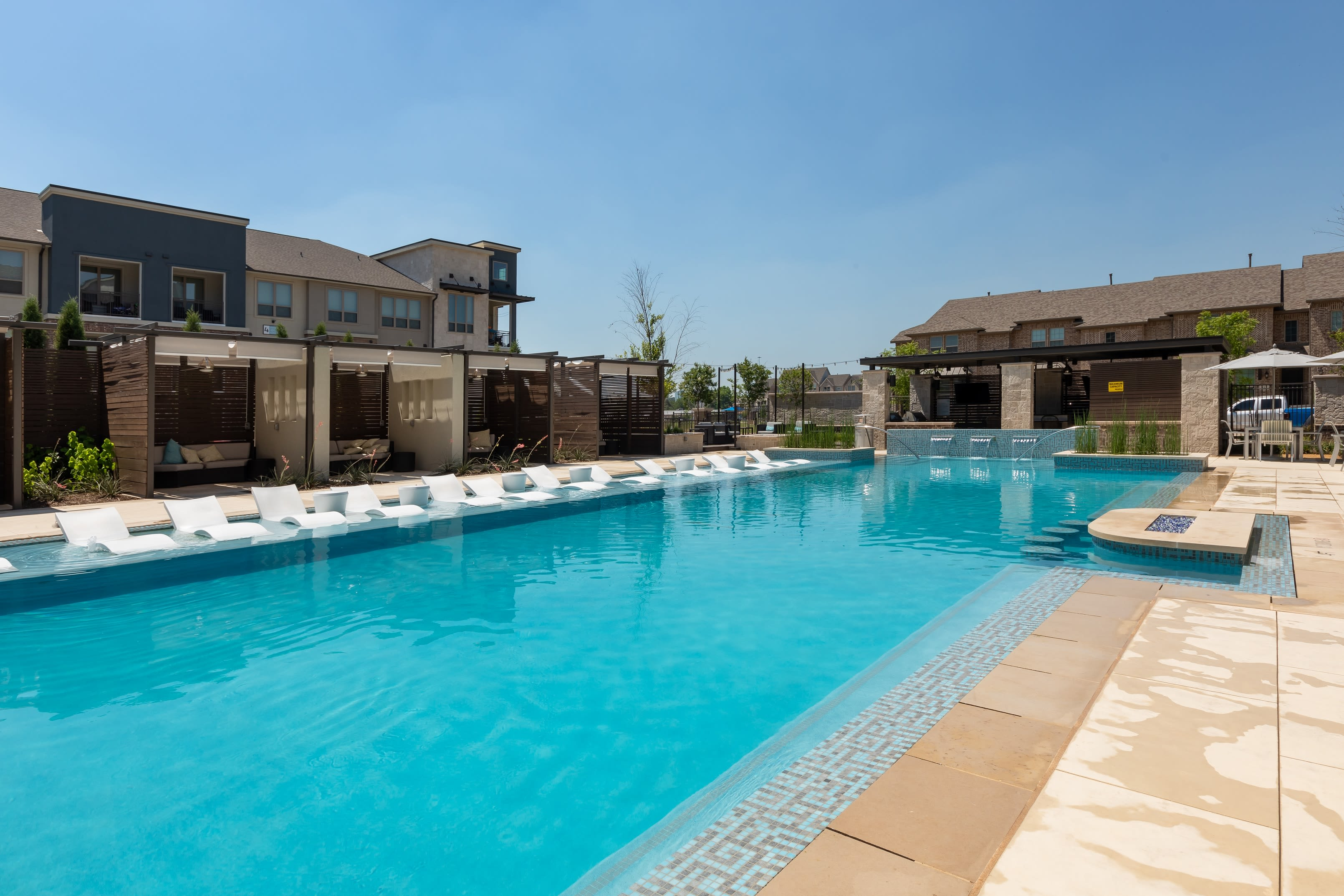 Resident poolside lounge area at Domain at Founders Parc in Euless, Texas