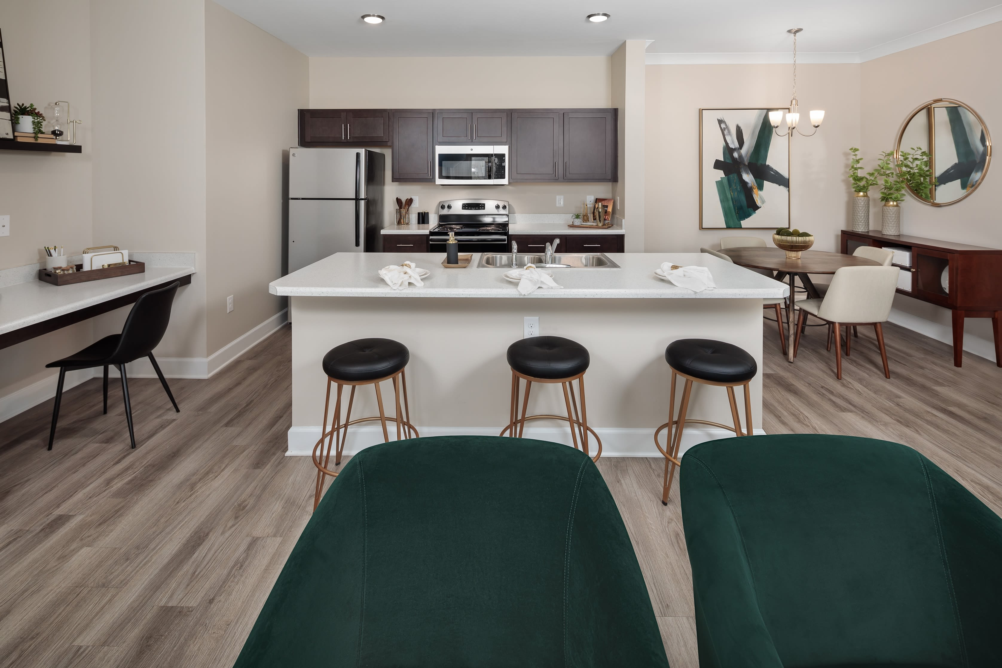 Large kitchen with dark cabinets and stainless steel appliances at The Isaac in Summerville, South Carolina