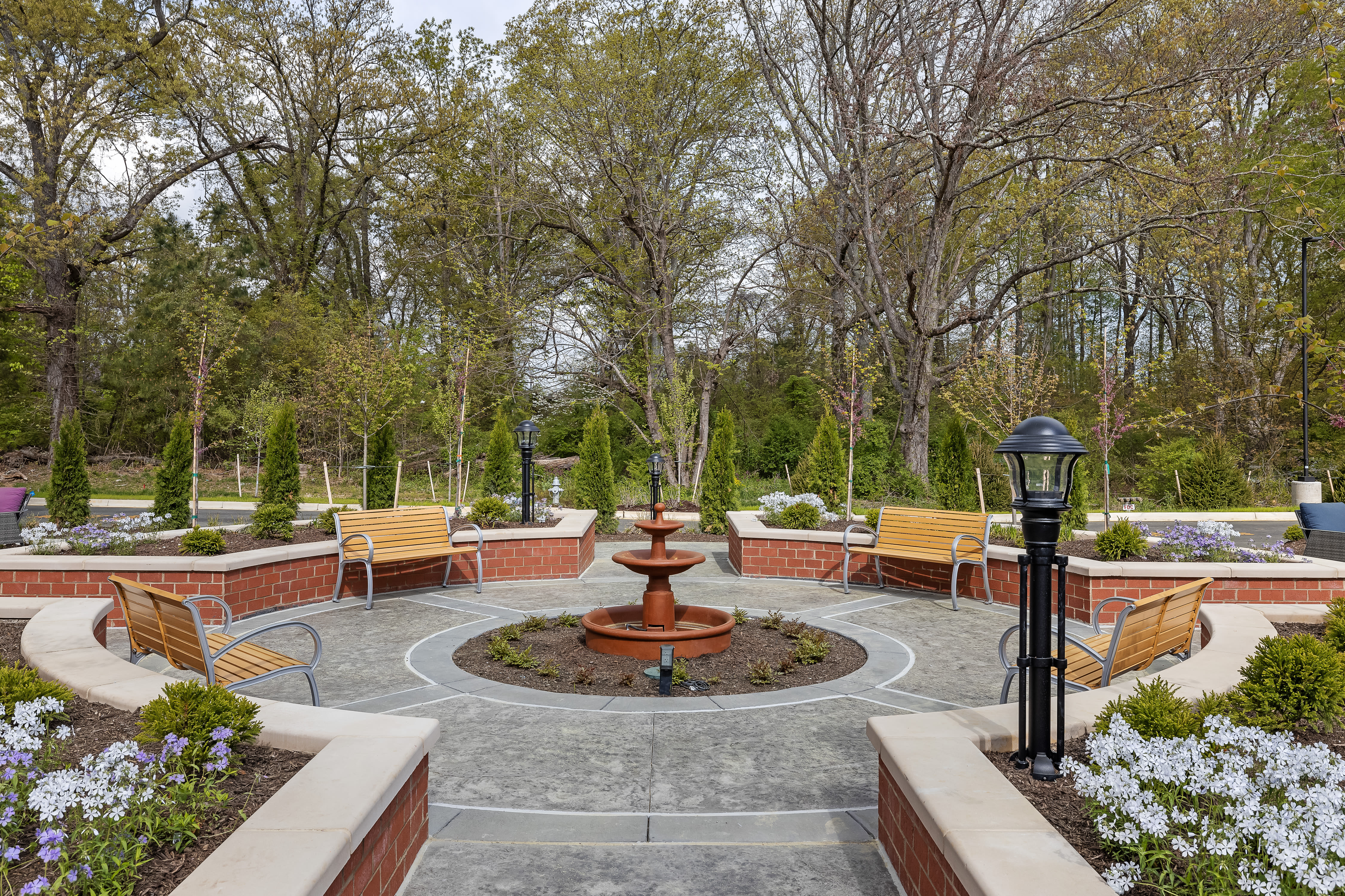 Courtyard with a fountain and trees at Anthology of Midlothian in North Chesterfield, Virginia.