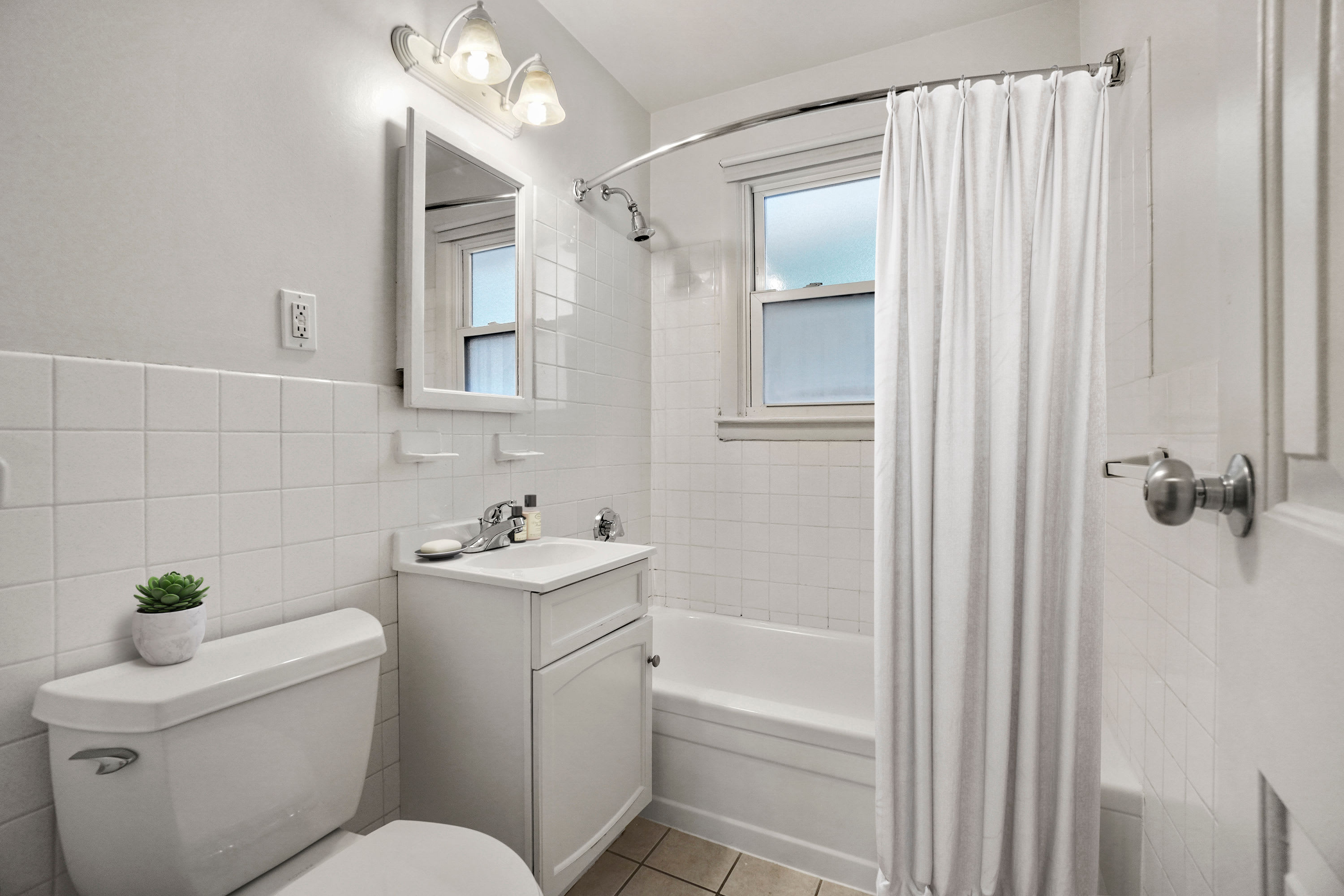 Rendered furnished bathroom at President Village in Fall River, Massachusetts