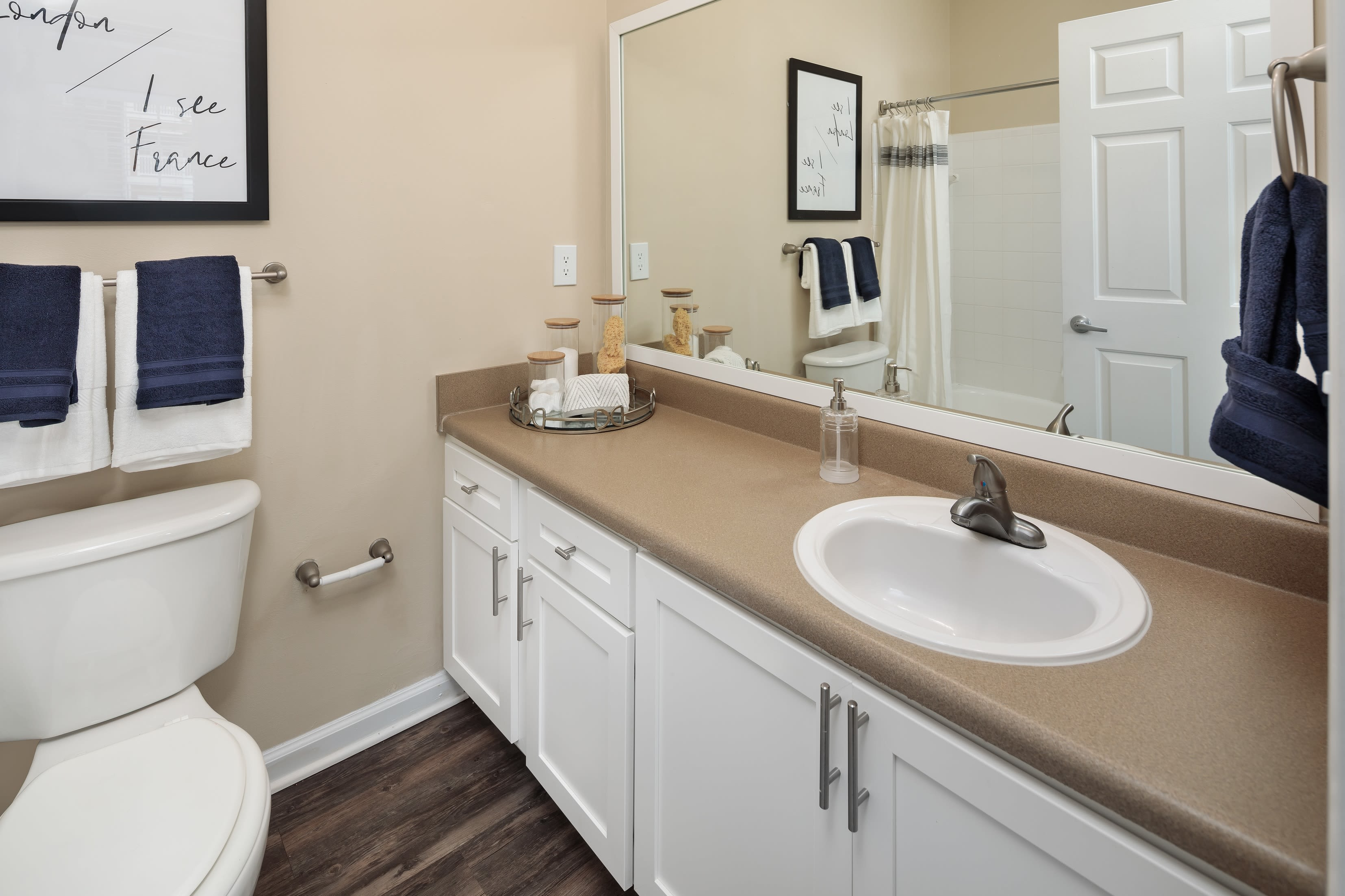 A bathroom in an apartment at Bryant at Summerville's swimming pool at Bryant at Summerville in Summerville, South Carolina