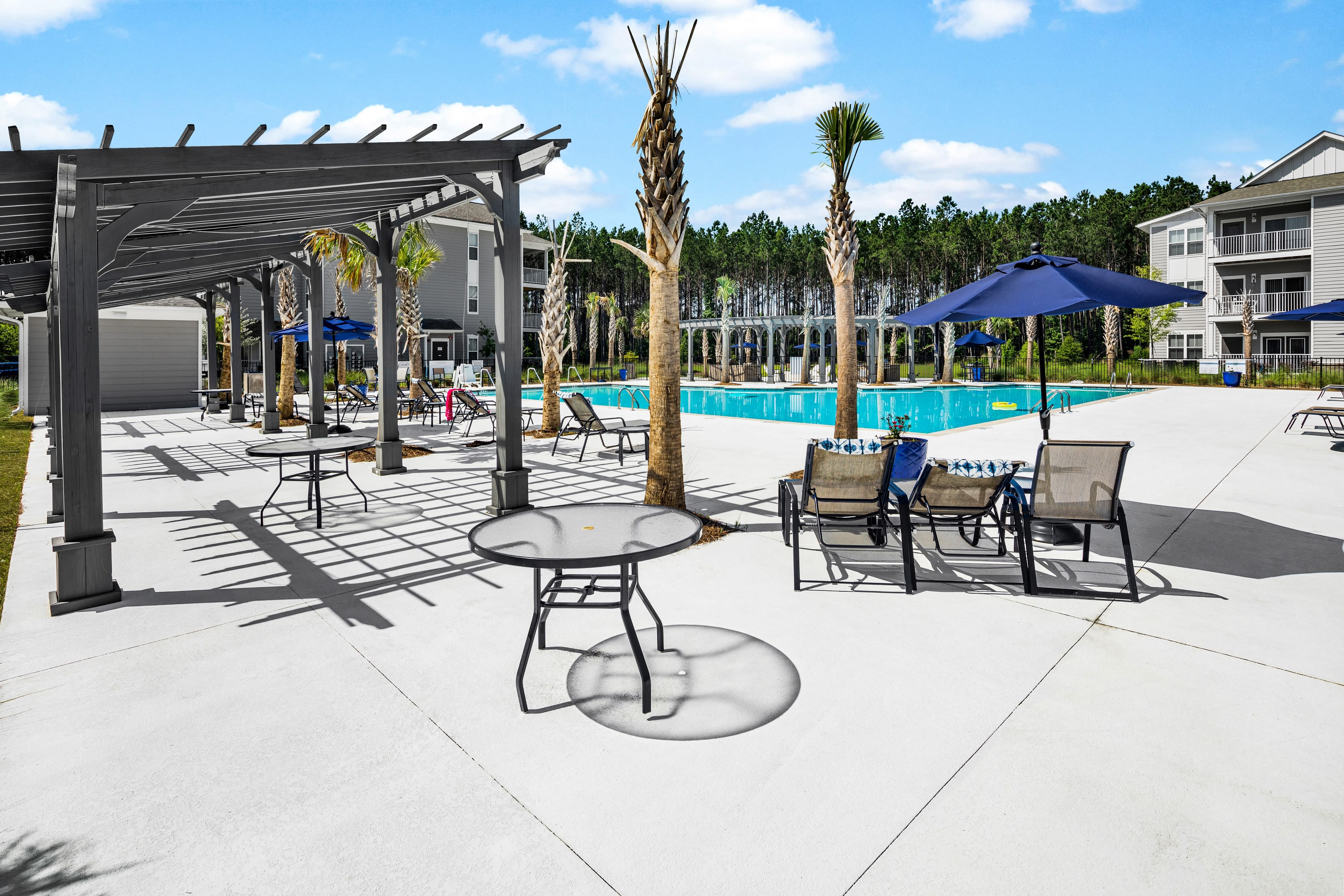 Outdoor pool area with seating at The Isaac in Summerville, South Carolina