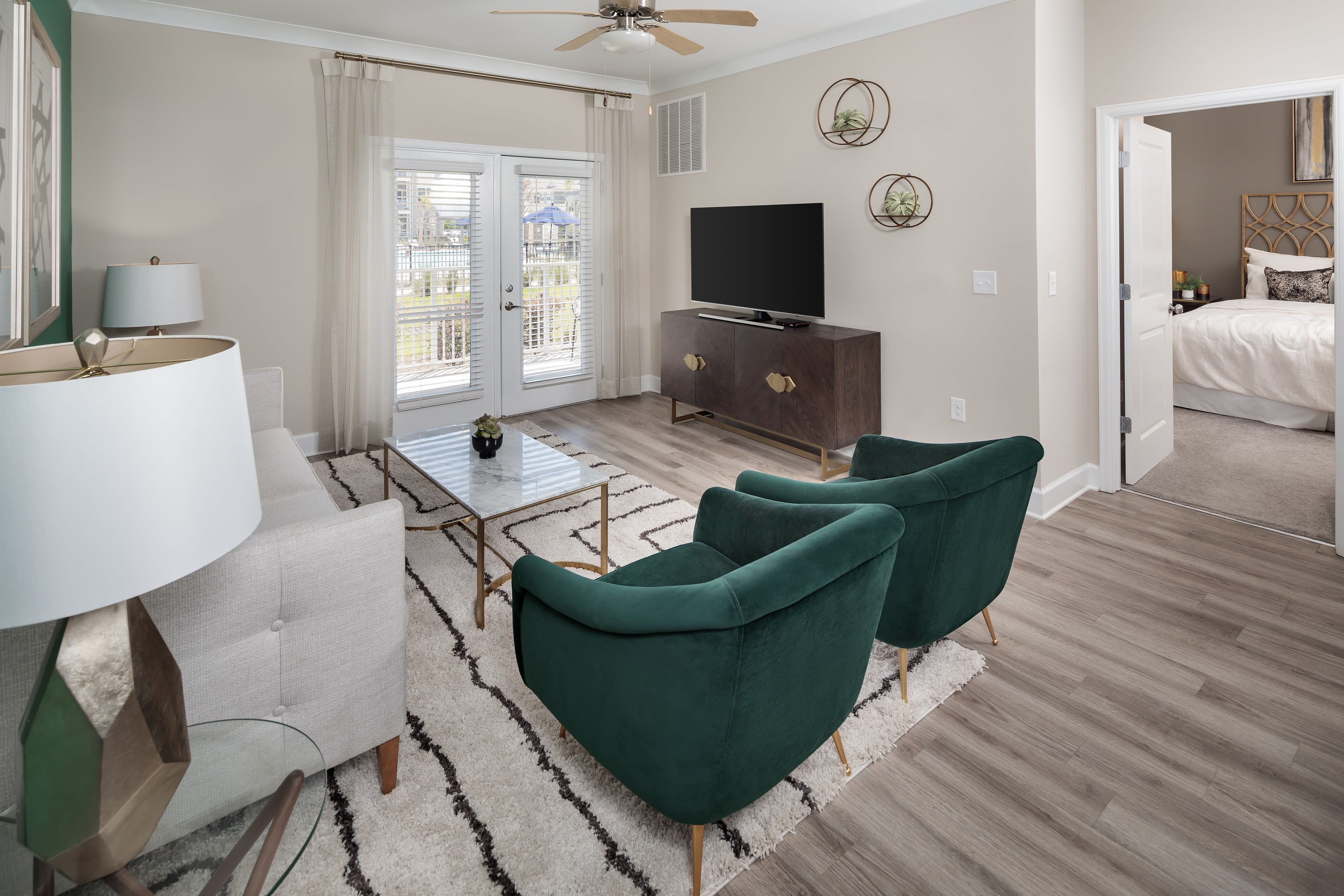 Spacious living room and kitchen area in a model home at The Isaac in Summerville, South Carolina