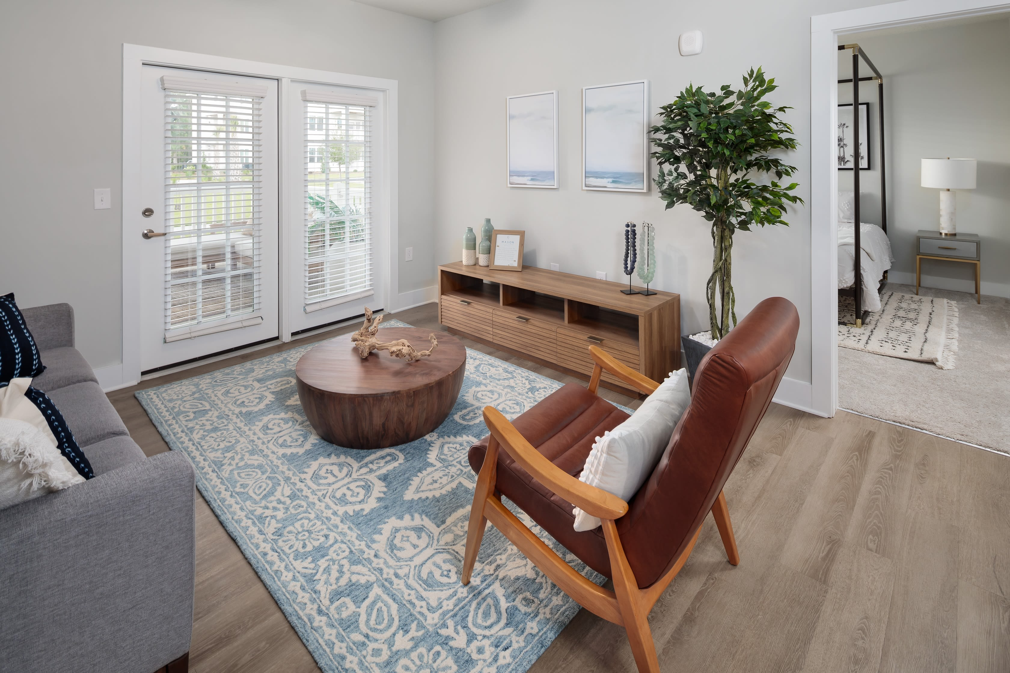 Spacious living room a in a model home at The Mason in Ladson, South Carolina