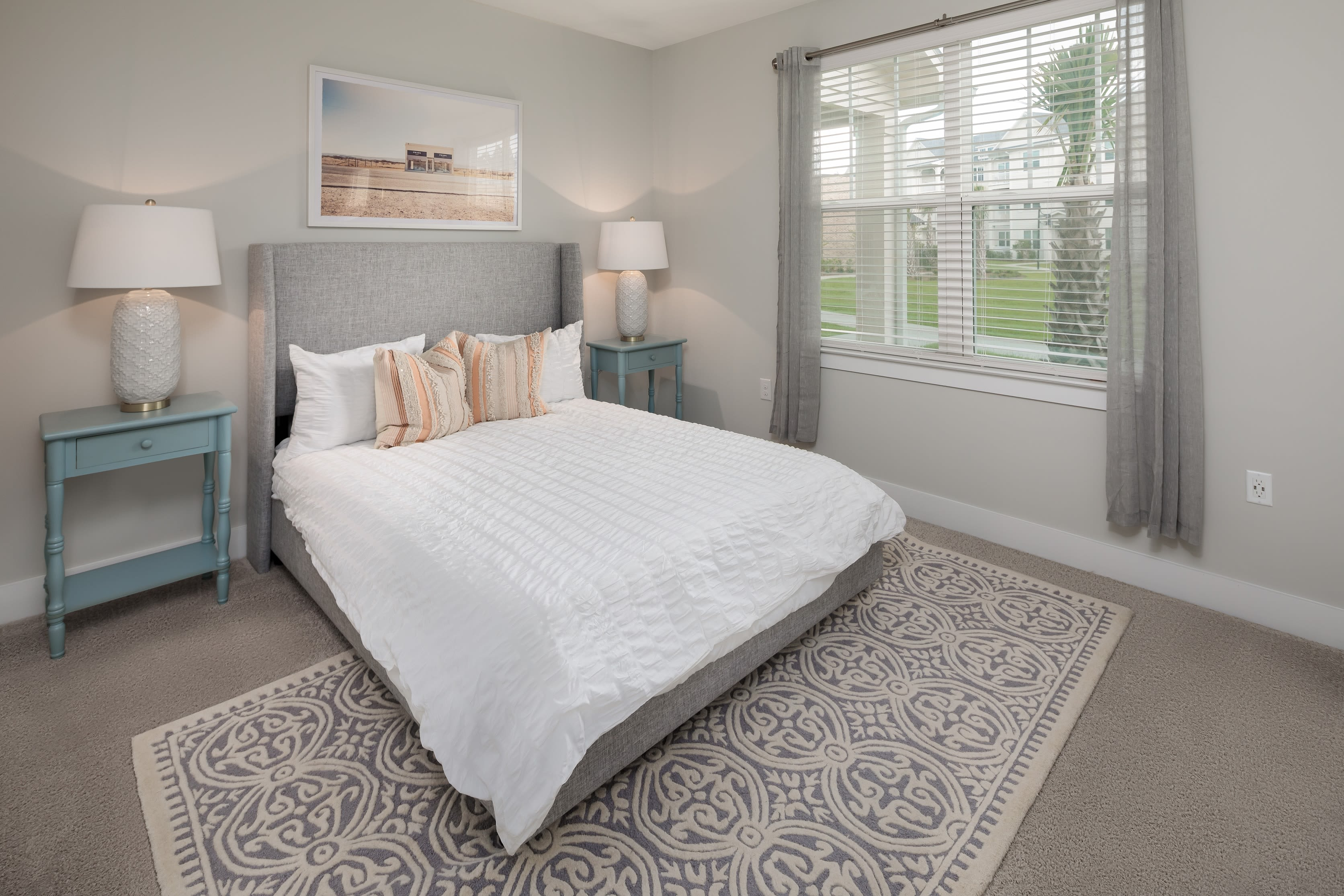 Large bedroom in a model apartment at The Mason in Ladson, South Carolina