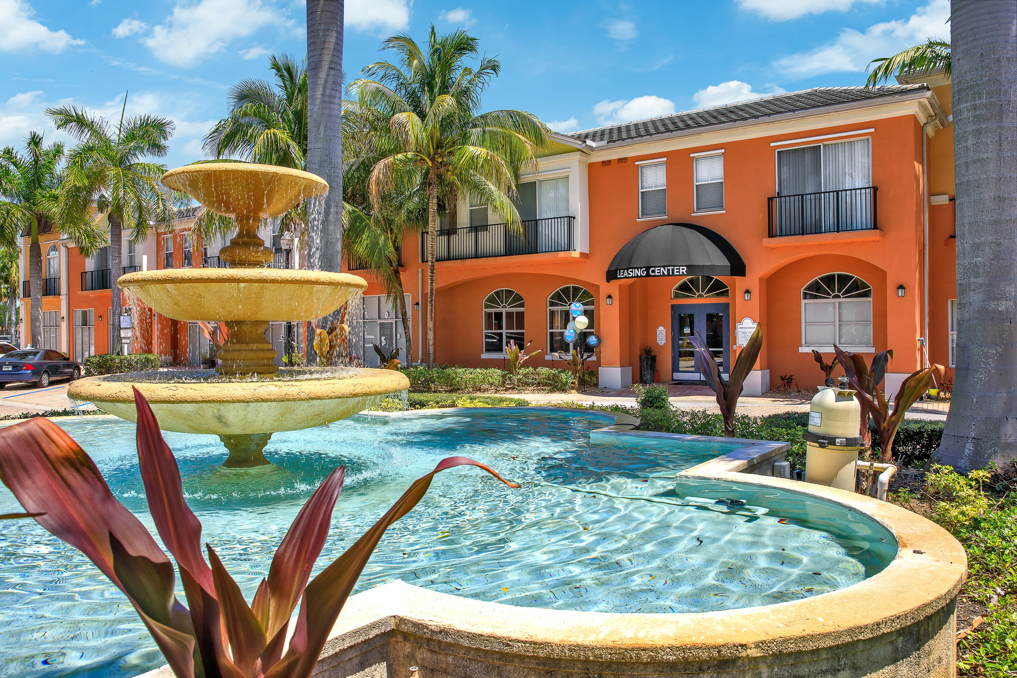Exterior view of gorgeous colorful building and palm trees at The Pearl in Ft Lauderdale, Florida