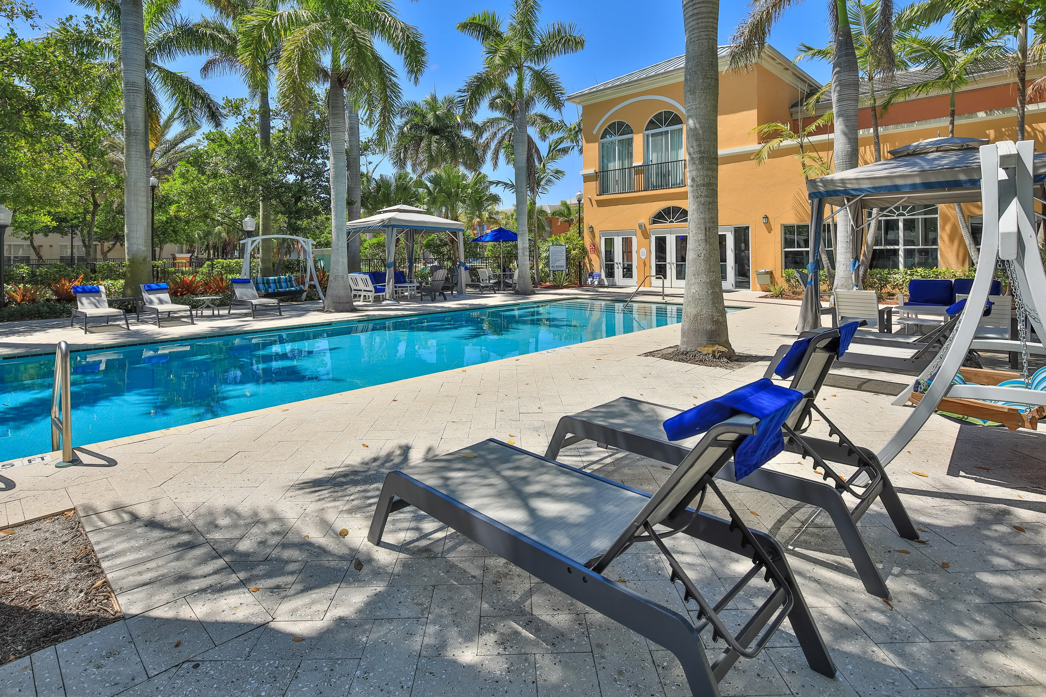 Gorgeous resort style swimming pool surrounded by lounge chairs at The Pearl in Ft Lauderdale, Florida