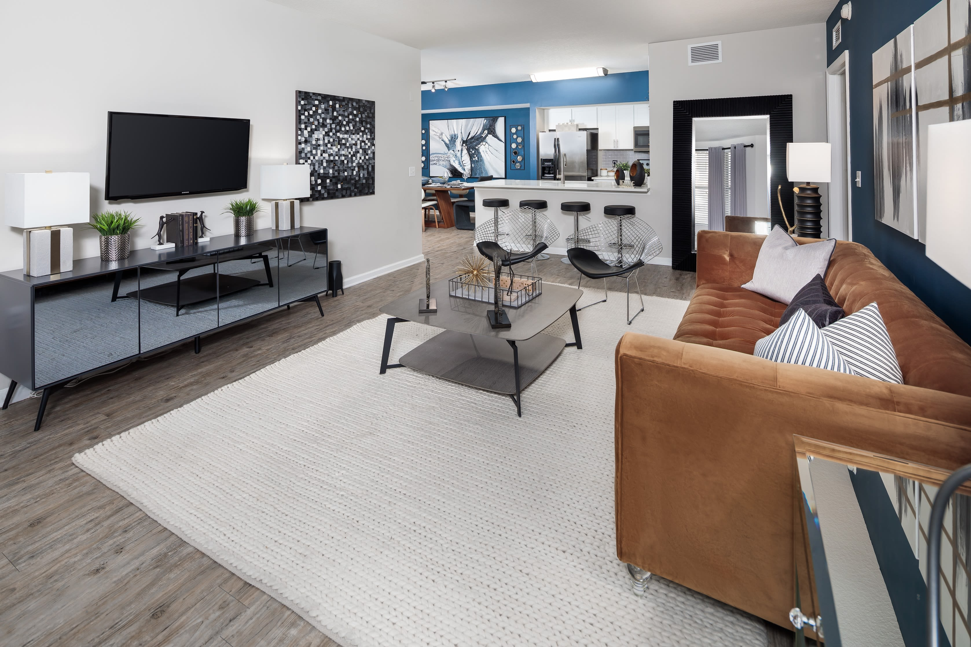 Spacious living area in decorated modern home with large windows for tons of light at The Pearl in Ft Lauderdale, Florida