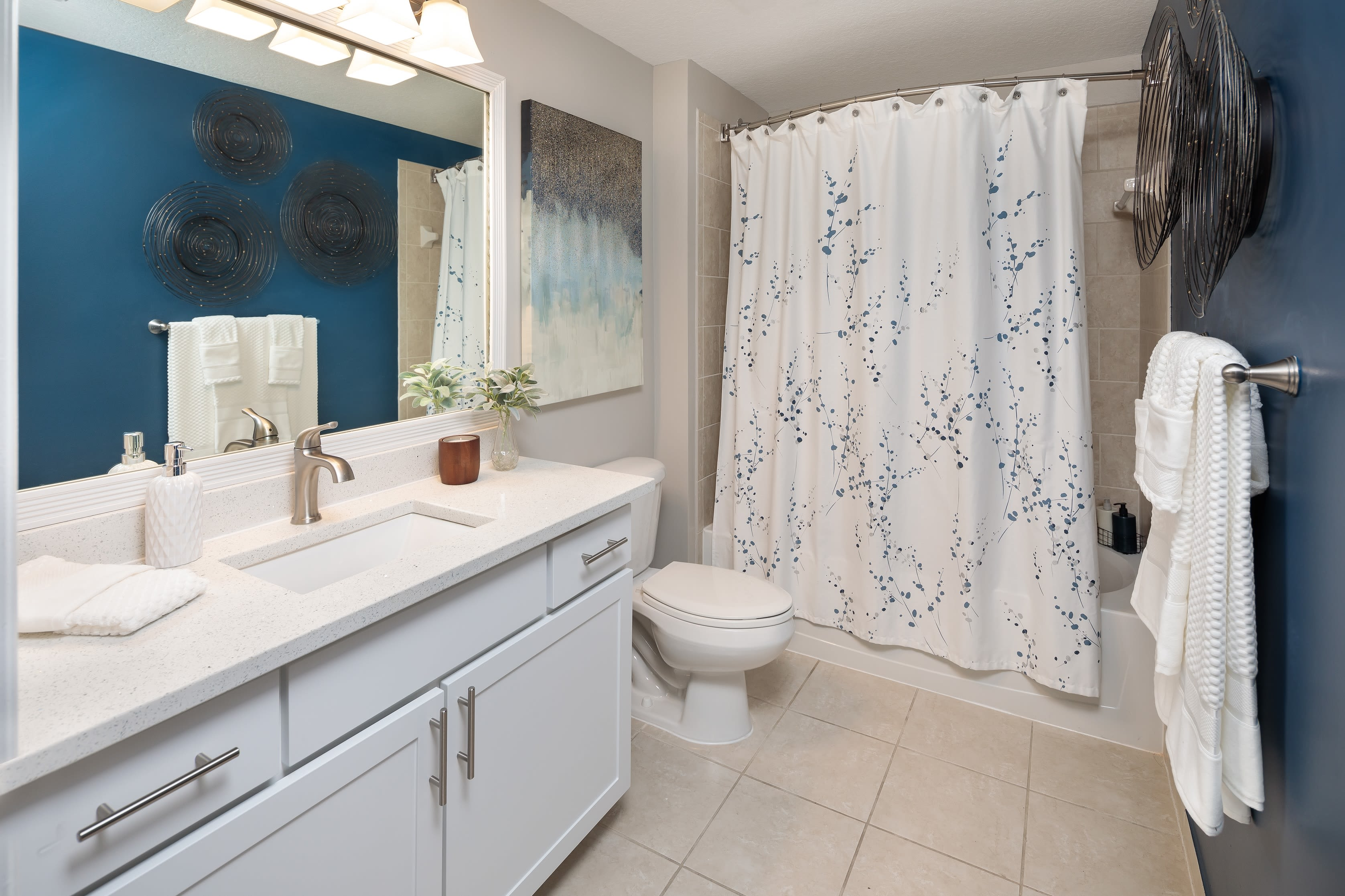 Nice bathroom with shower and large vanity mirror at The Pearl in Ft Lauderdale, Florida