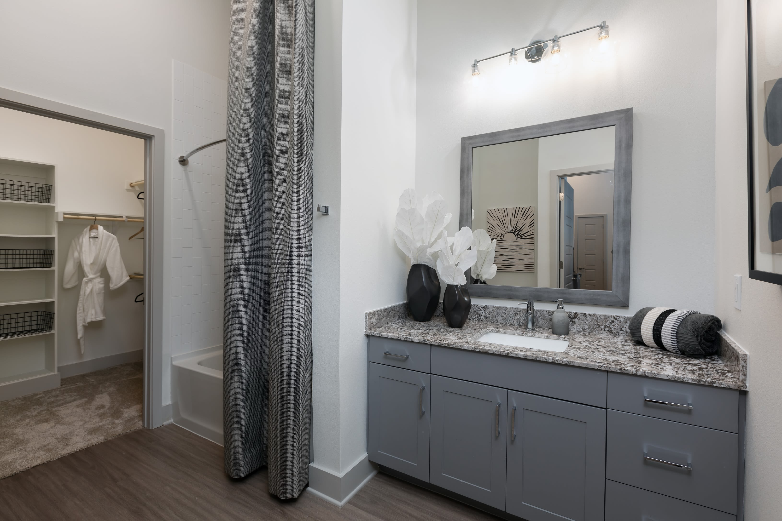 Roomy bathroom with lots of storage space and vanity at The ReVe in Garland, Texas