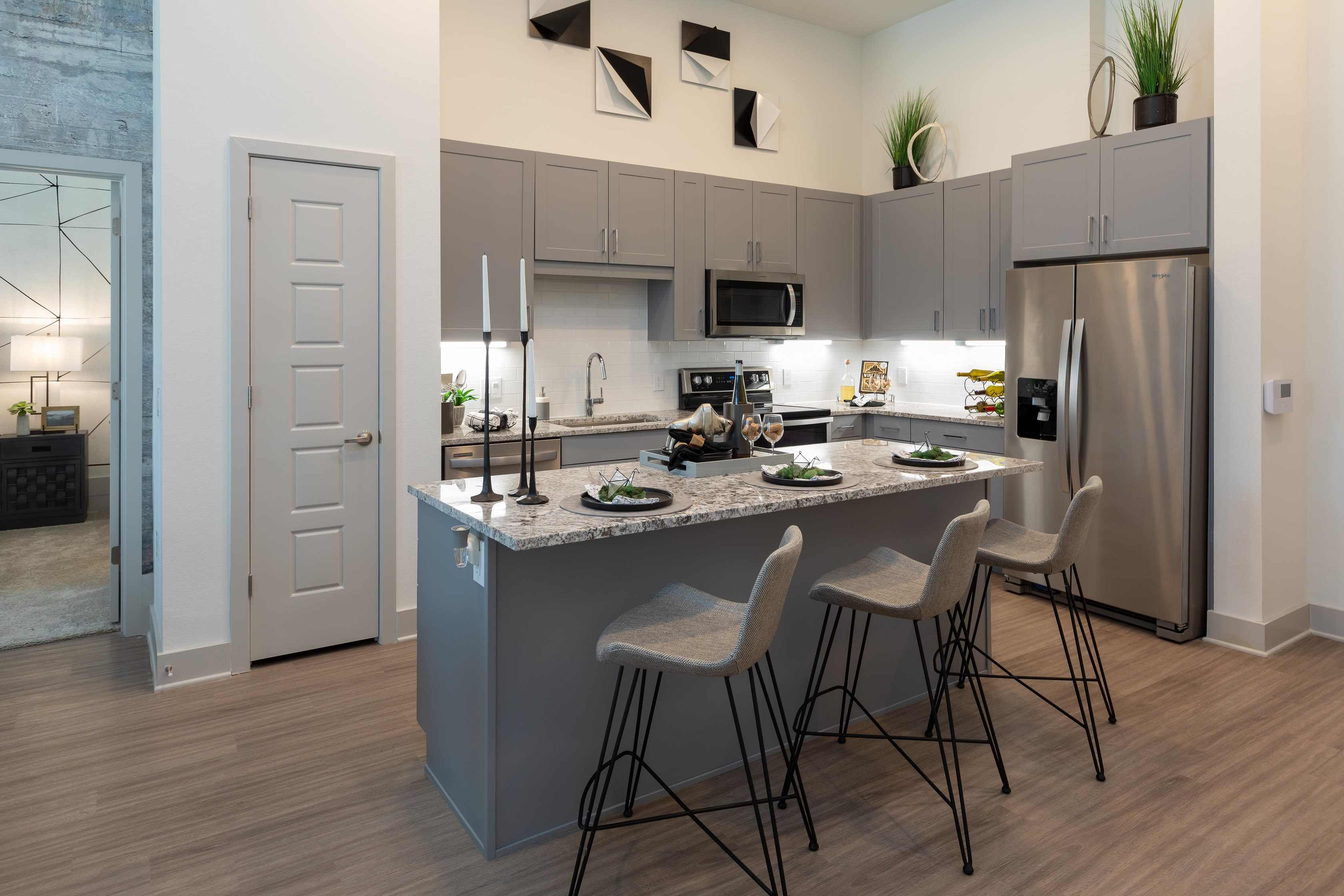 Updated kitchen in a model apartment at The ReVe in Garland, Texas