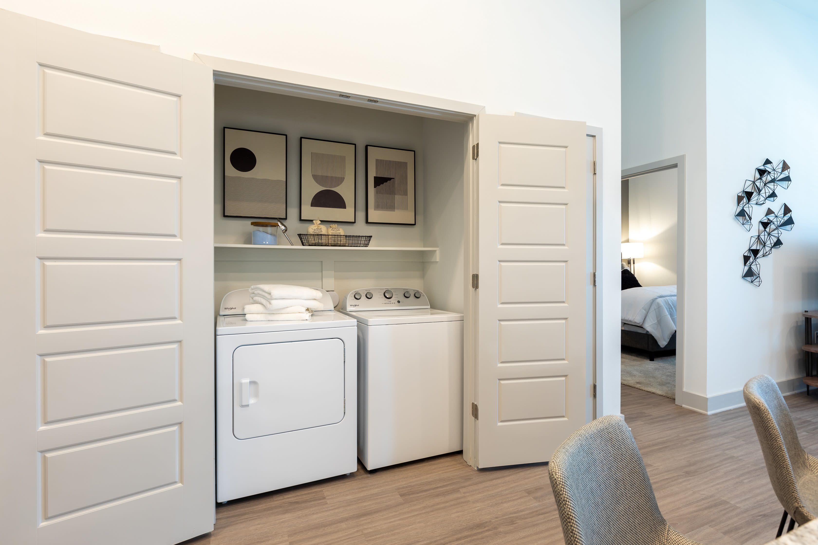 In unit washer and dryer with storage at The ReVe in Garland, Texas