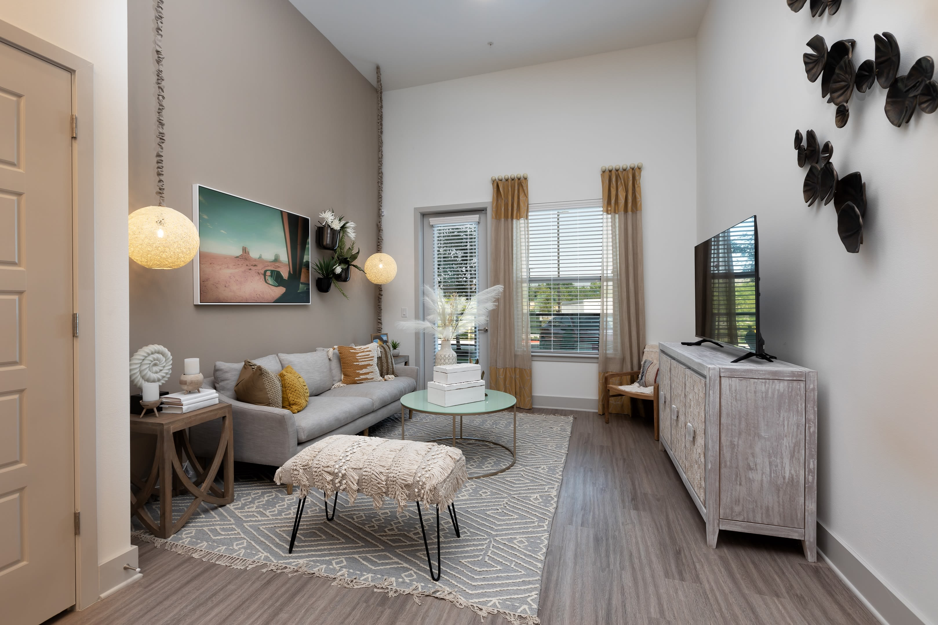 Open concept kitchen and living room at The ReVe in Garland, Texas