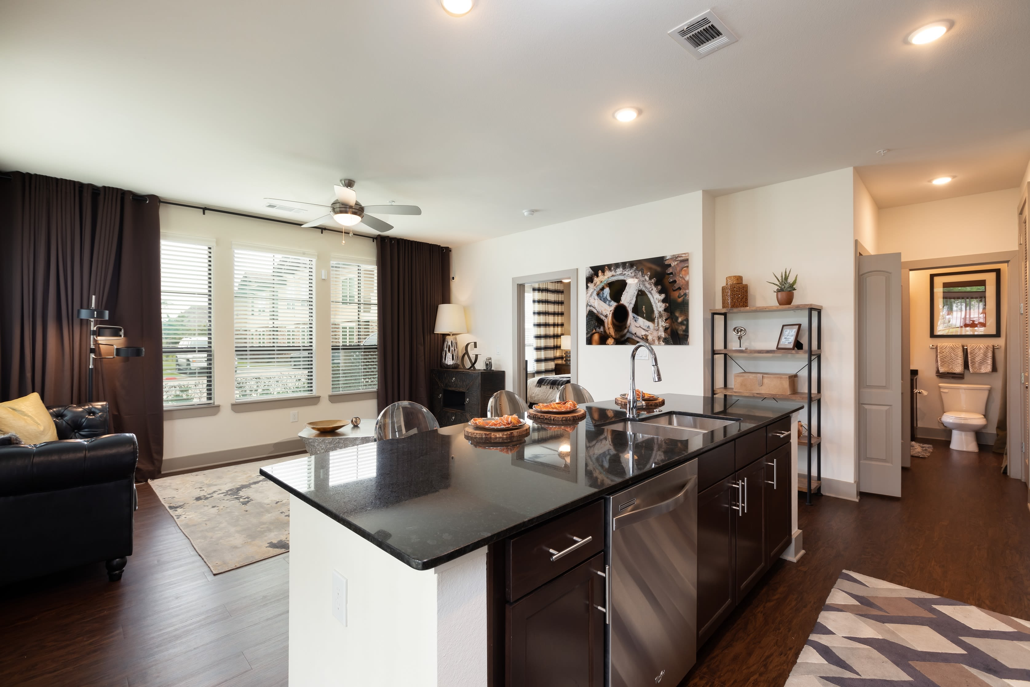 Well-furnished kitchen area with hardwood floors in a model home at Waterford Trails in Spring, Texas
