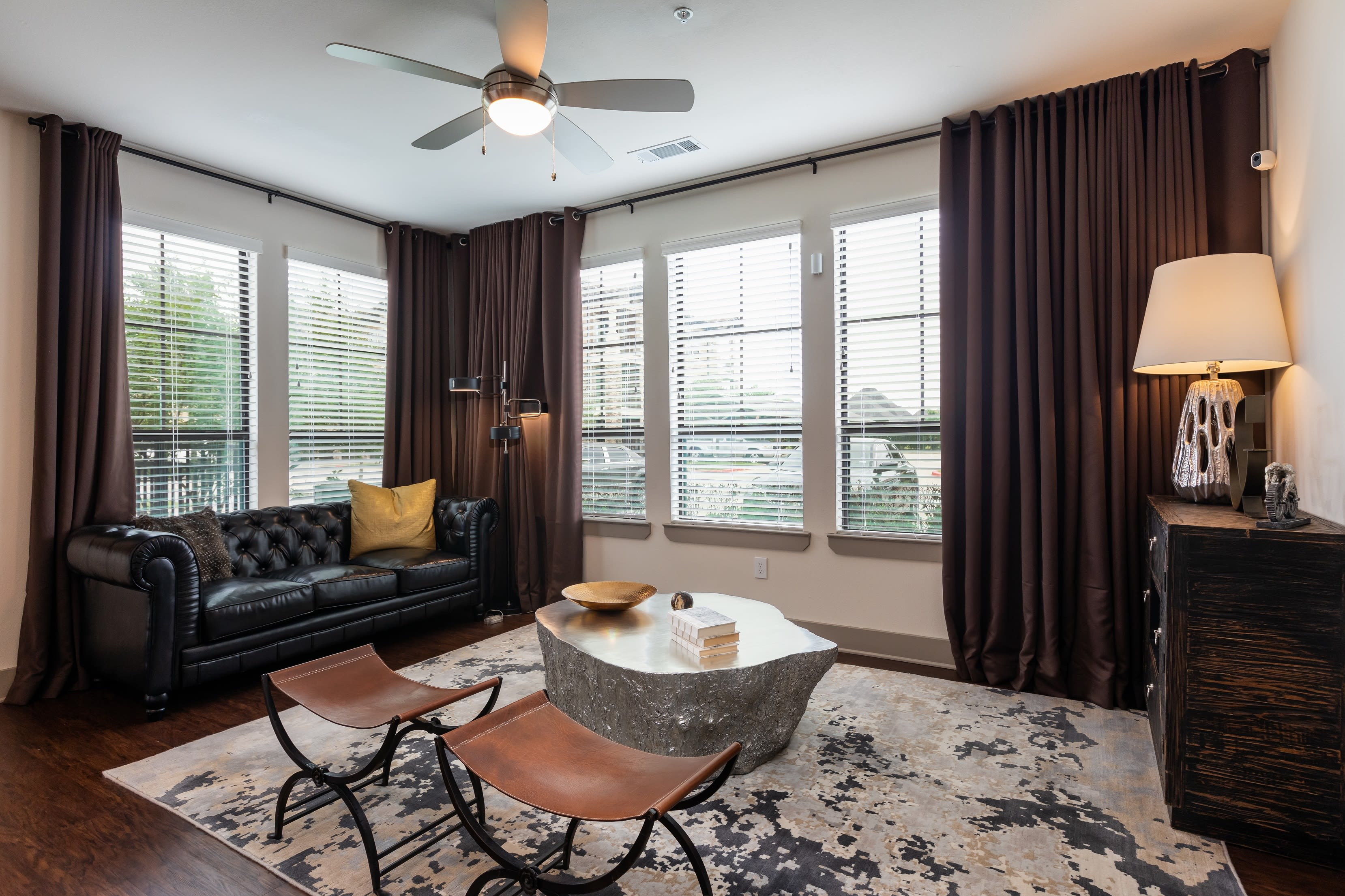 Well-decorated open-concept living space in a model home at Waterford Trails in Spring, Texas