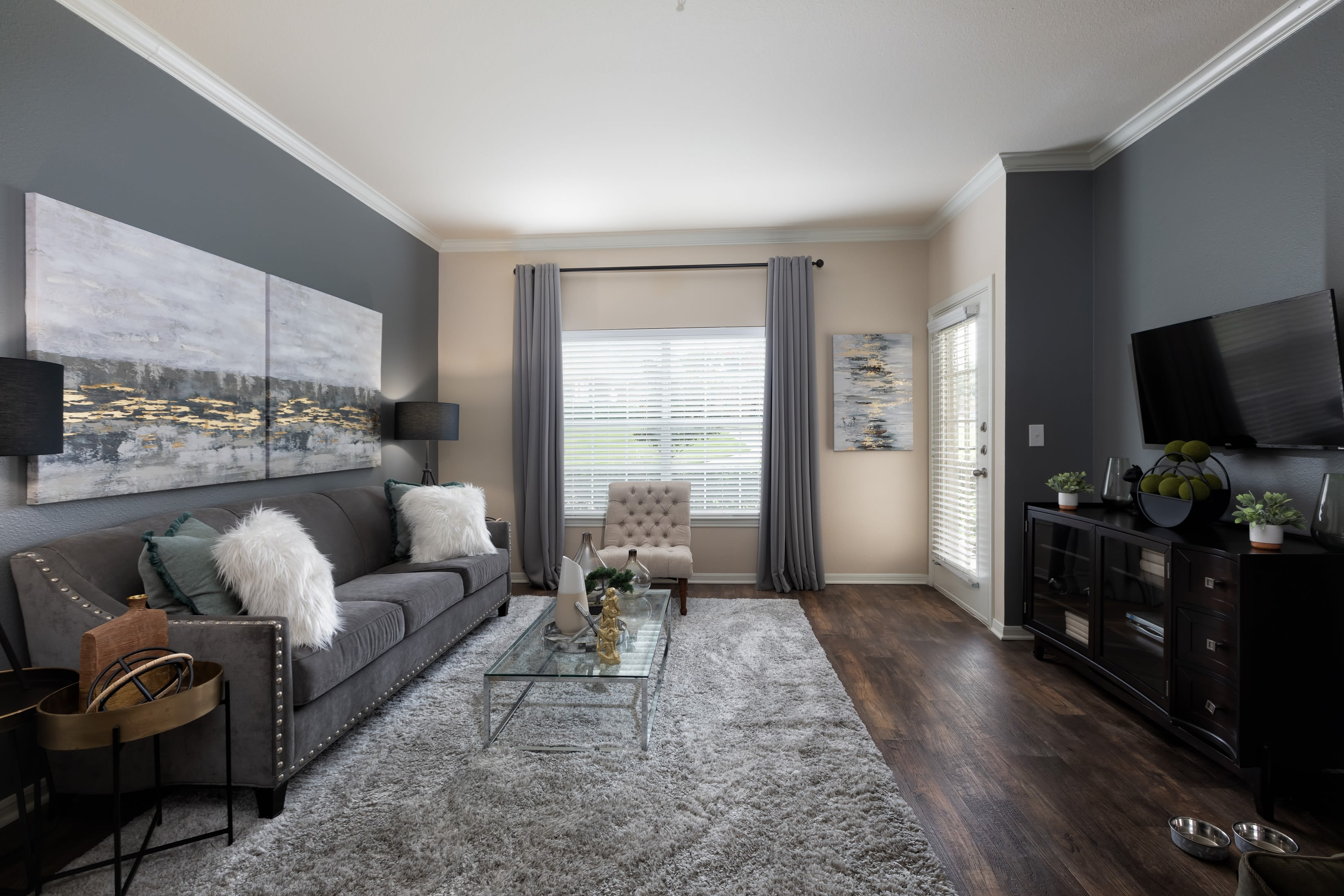 Well-decorated living room in model home at Ranch at Hudson Xing in McKinney, Texas