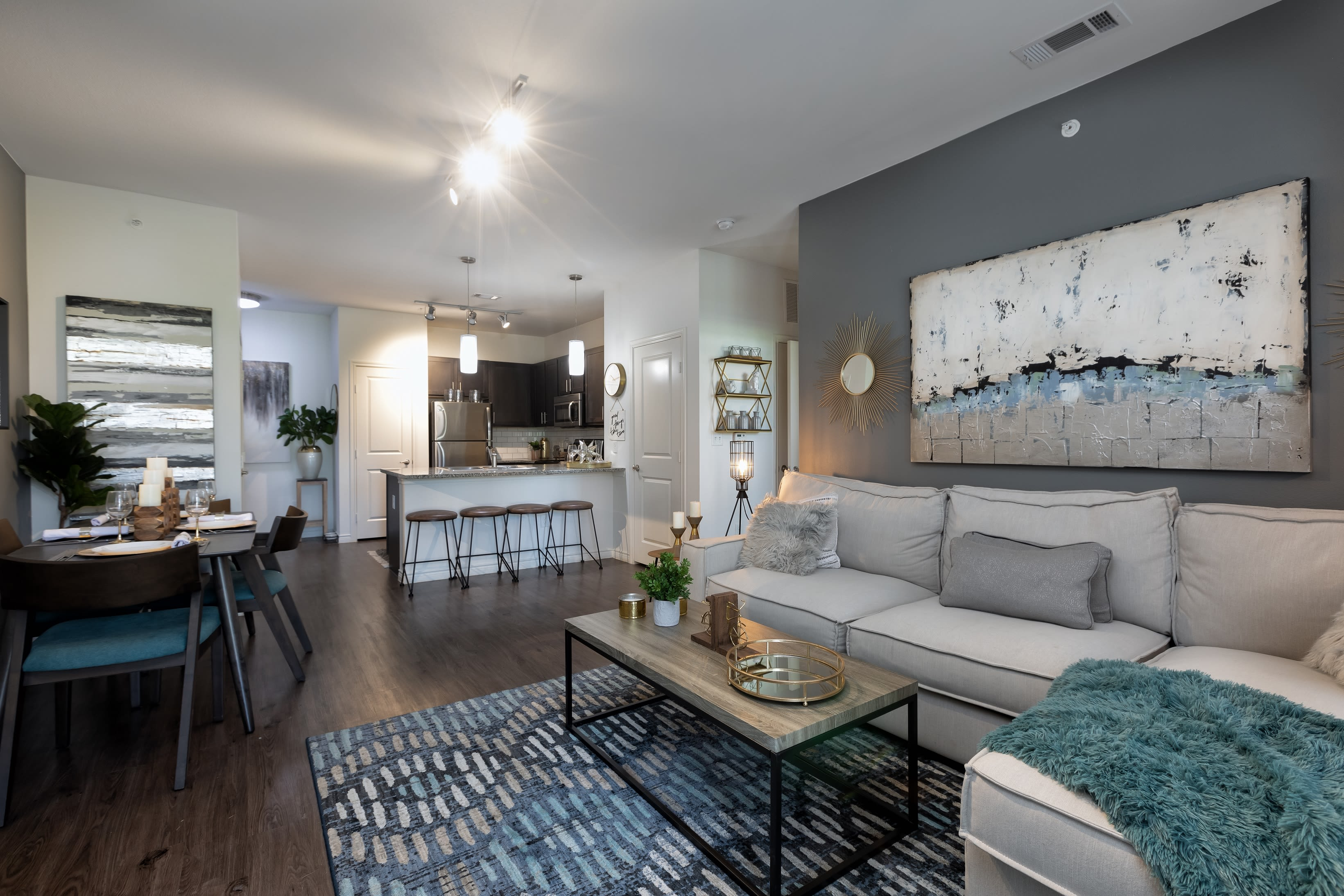 Well-decorated living room in model home at 4 Corners Apartments in Frisco, Texas