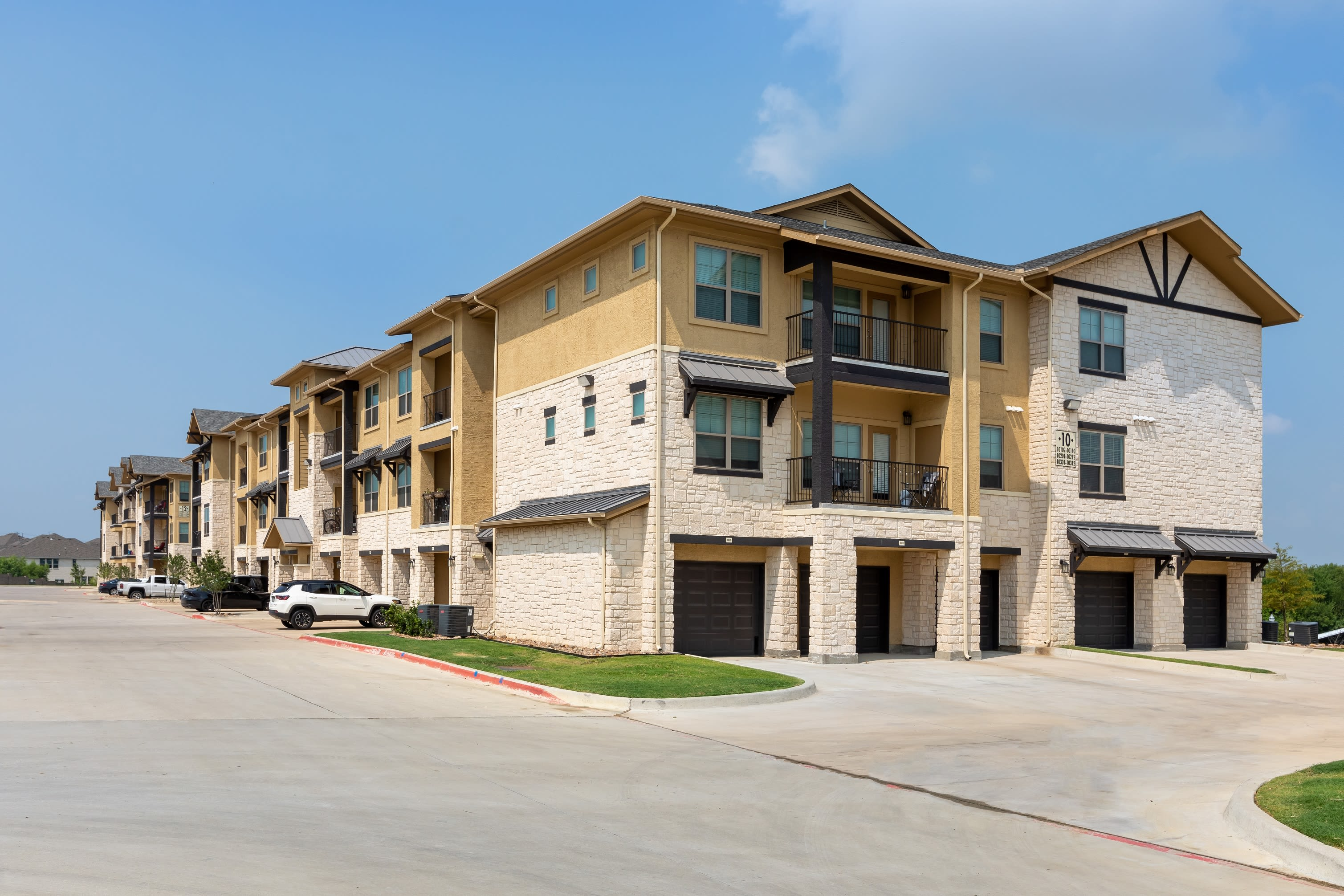 Garages for select units at 4 Corners Apartments in Frisco, Texas