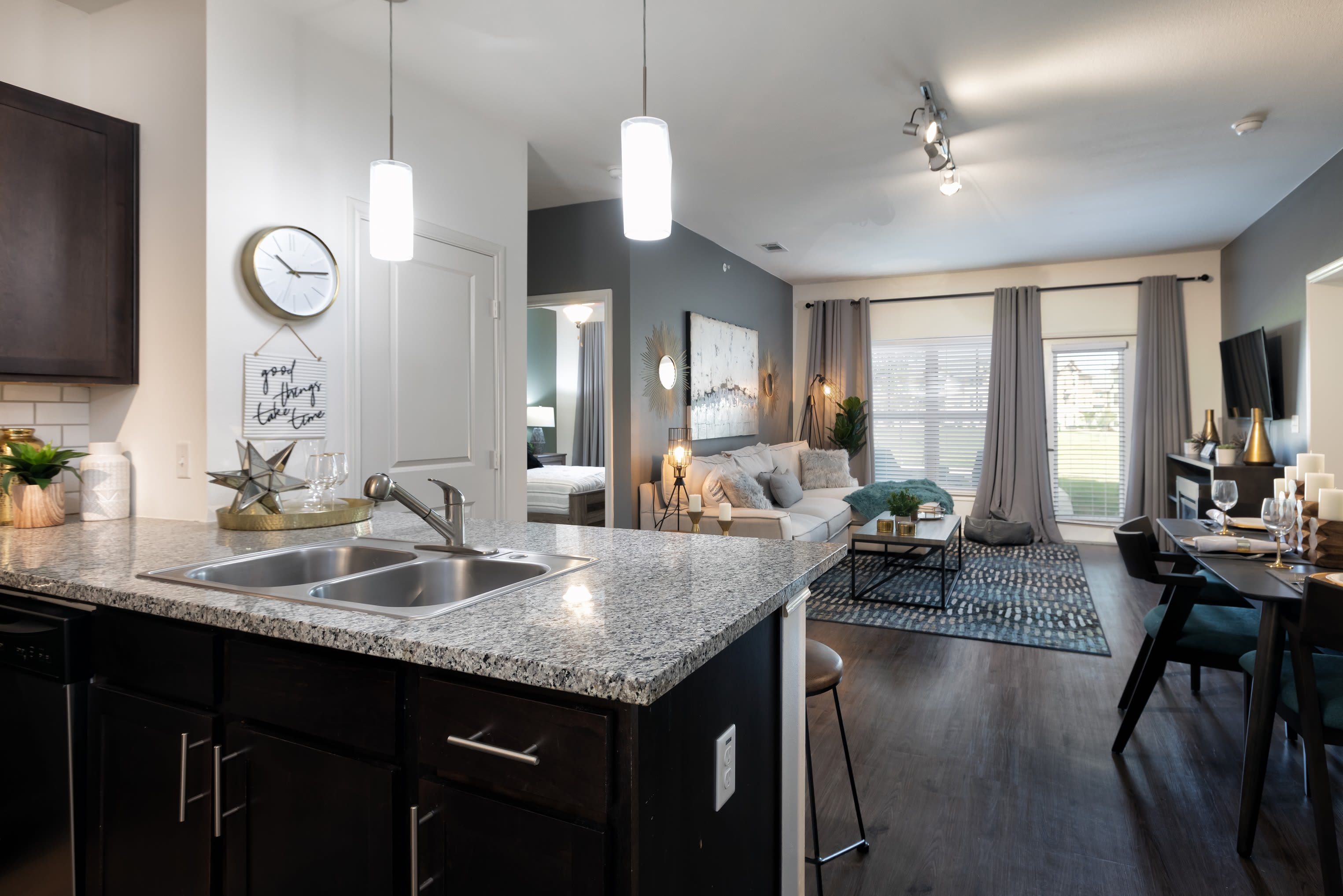 Open concept kitchen in a model apartment at 4 Corners Apartments in Frisco, Texas