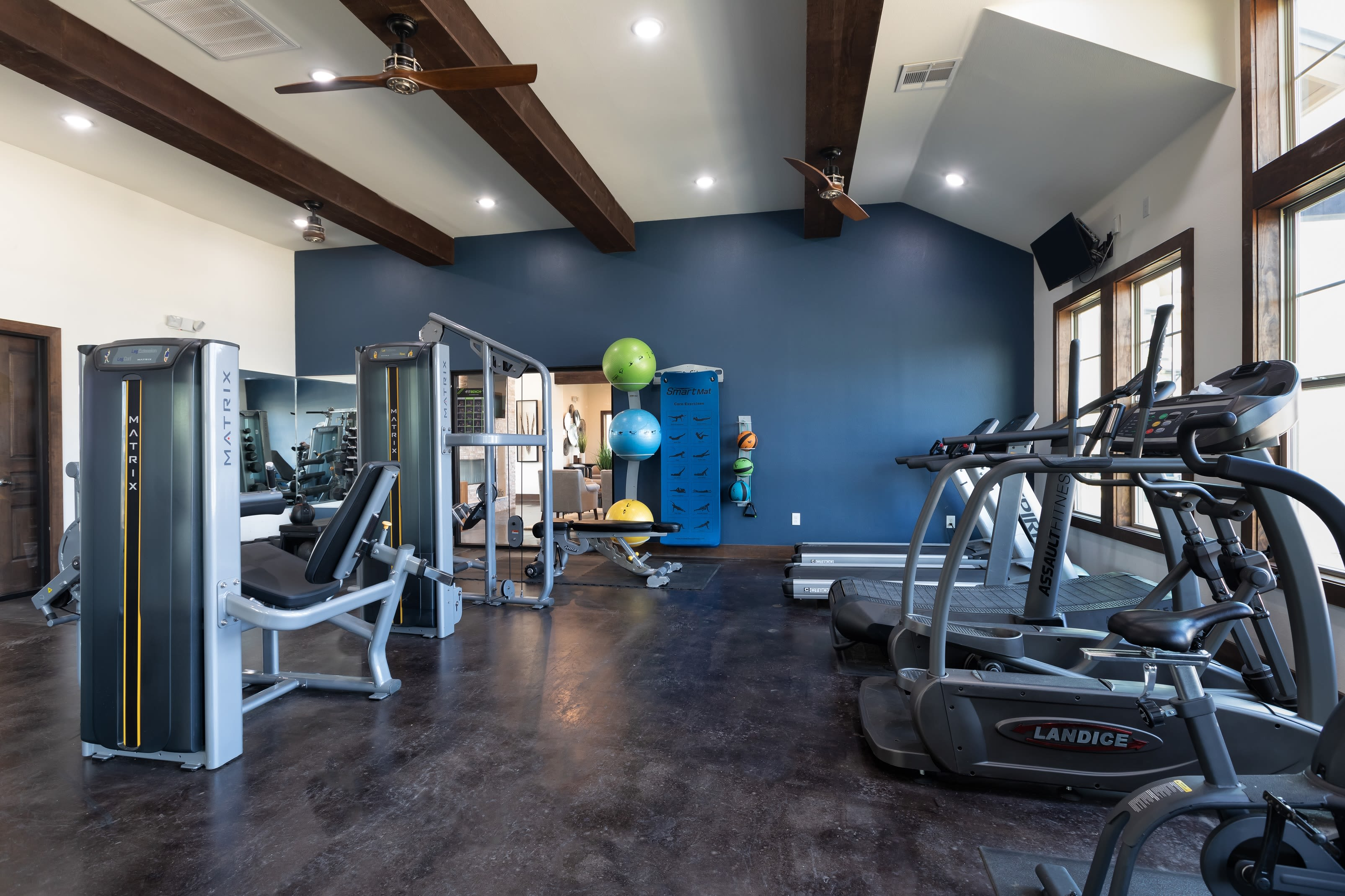 Well equipped fitness center at 4 Corners Apartments in Frisco, Texas
