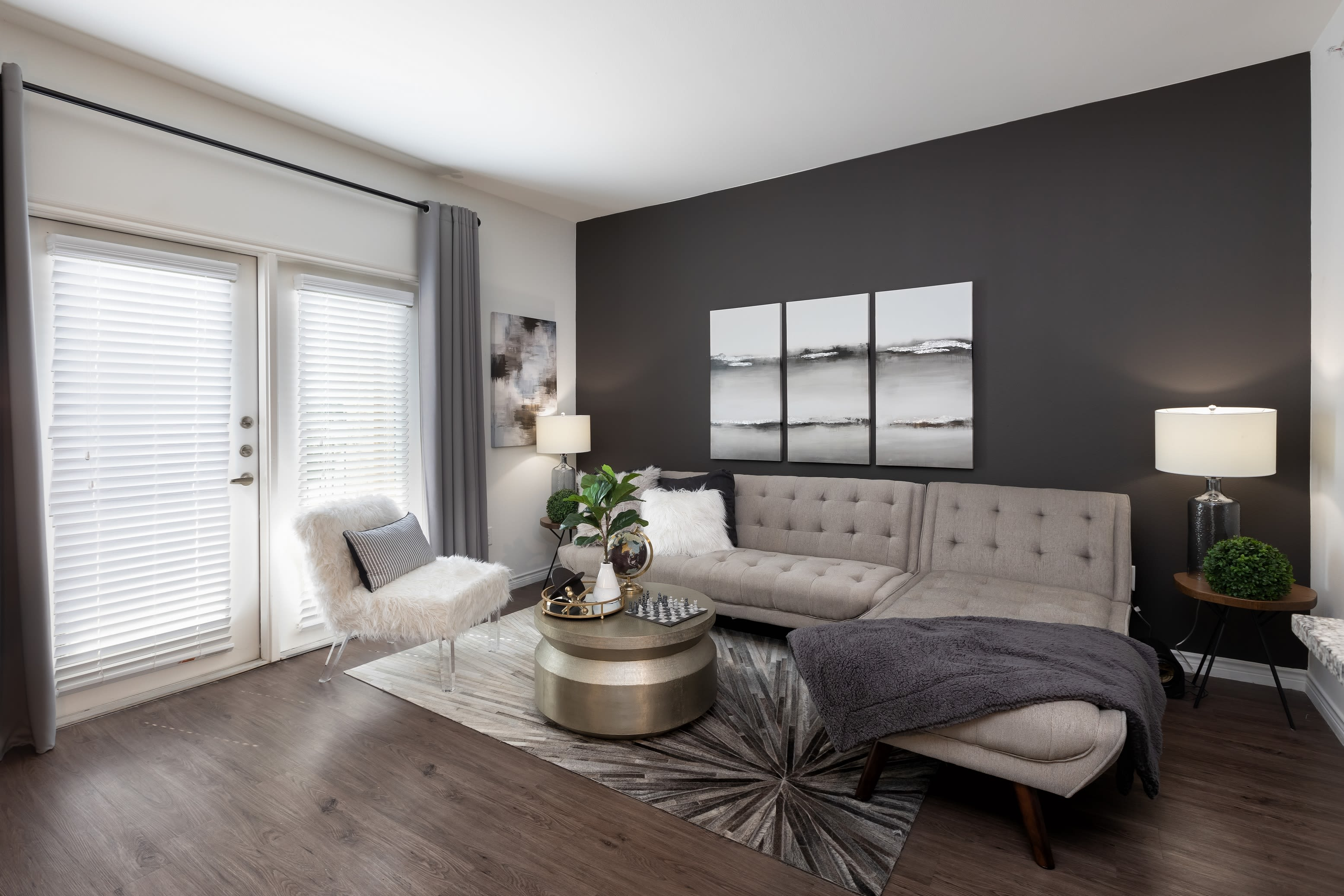 A furnished living room in a model apartment at 4 Corners Apartments in Frisco, Texas