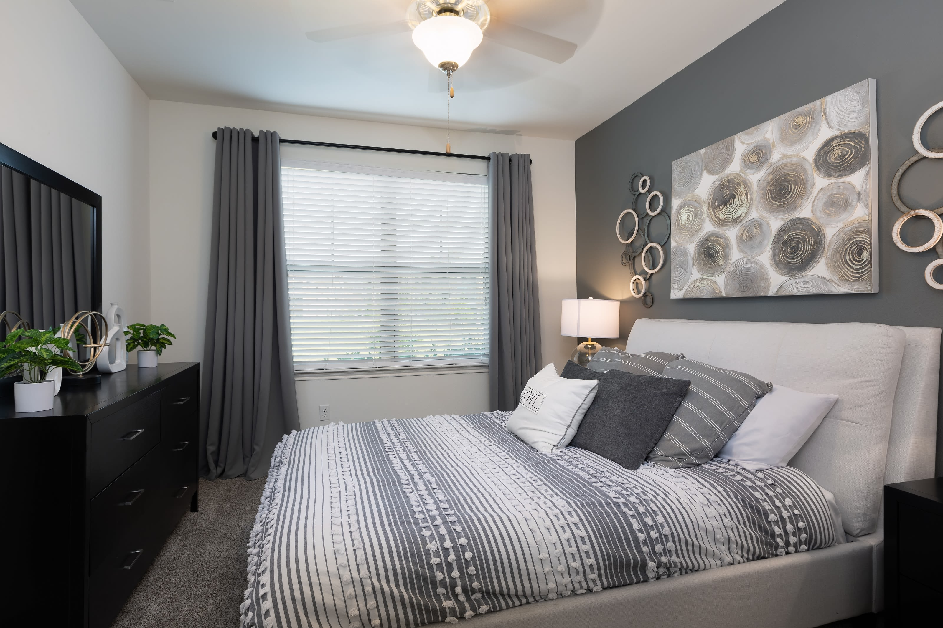 A furnished bedroom in a model apartment at 4 Corners Apartments in Frisco, Texas