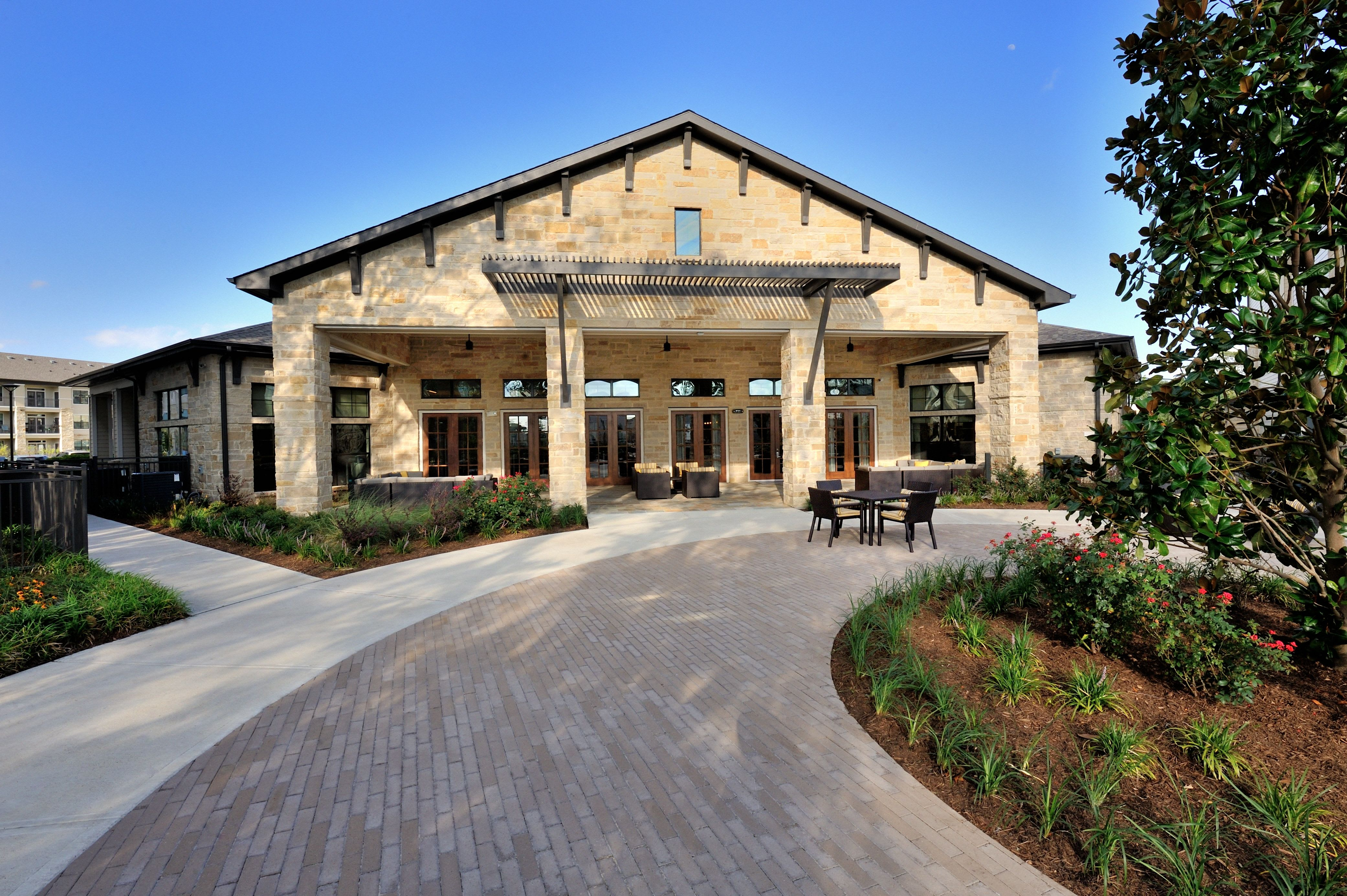 Exterior of community clubhouse at Olympus Falcon Landing in Katy, TX